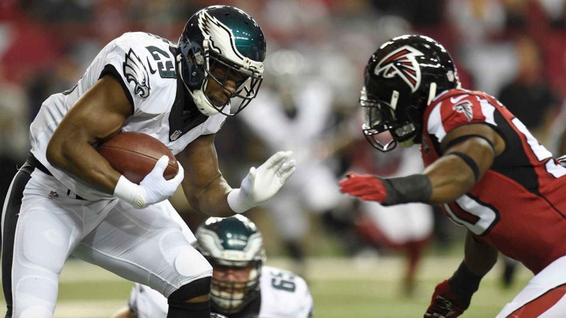 Sep 14, 2015; Atlanta, GA, USA; Philadelphia Eagles running back DeMarco Murray (29) carries the ball as he is chased by Atlanta Falcons linebacker O'Brien Schofield (50) in the first quarter at the Georgia Dome. Mandatory Credit: Dale Zanine-USA TODAY Sports