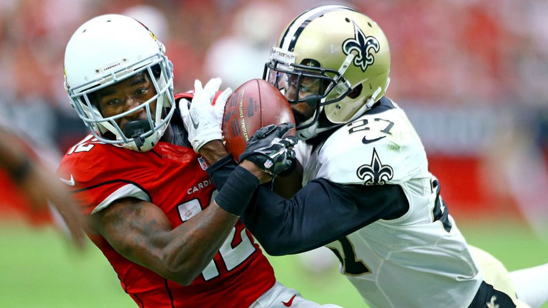 Sep 13, 2015; Glendale, AZ, USA; New Orleans Saints cornerback Damian Swann (right) breaks up a pass intended for Arizona Cardinals wide receiver John Brown in the second quarter at University of Phoenix Stadium. Mandatory Credit: Mark J. Rebilas-USA TODAY Sports