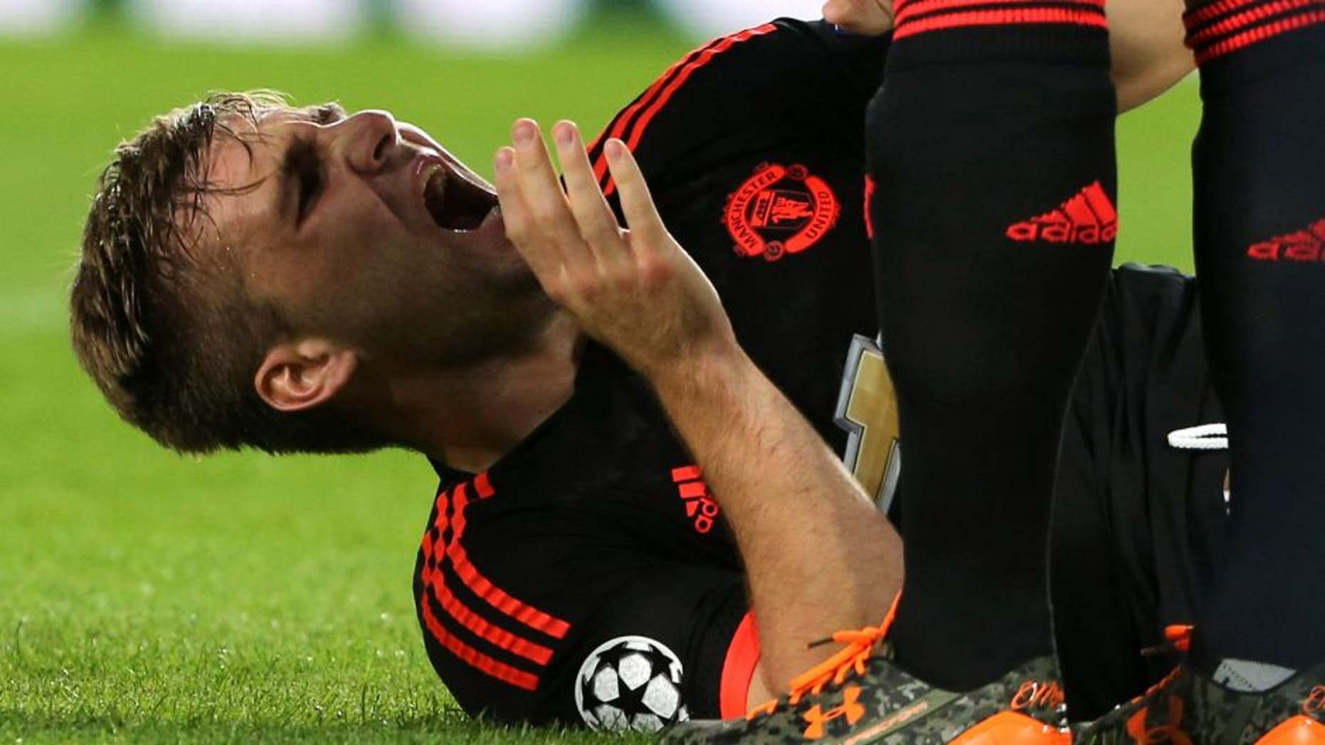 EINDHOVEN, NETHERLANDS - SEPTEMBER 15: Luke Shaw of Manchester United receives treatment on a leg injury during the UEFA Champions League match between PSV Eindhoven and Manchester United at Philips Stadion on September 15, 2015 in Eindhoven, Netherlands. (Photo by John Peters/Man Utd via Getty Images)
