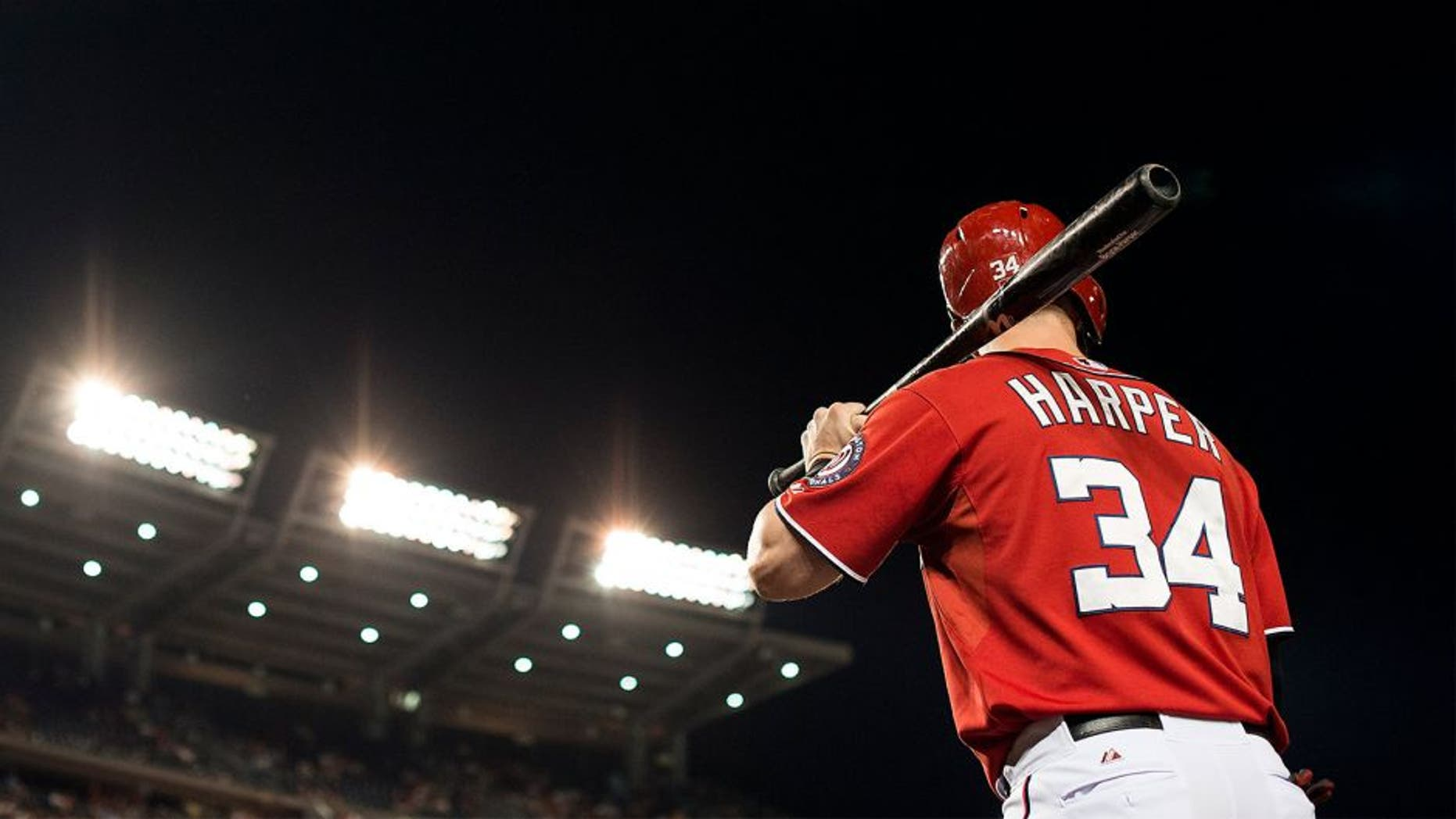 WASHINGTON, DC - AUGUST 22: Bryce Harper #34 of the Washington Nationals stands on deck before batting against the Milwaukee Brewers in the seventh inning of a baseball game at Nationals Park on August 22, 2015 in Washington, DC. (Photo by Patrick McDermott/Washington Nationals/Getty Images)