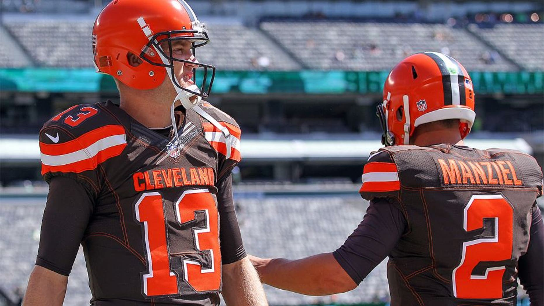 Sep 13, 2015; East Rutherford, NJ, USA; Cleveland Browns quarterback Johnny Manziel (2) and Cleveland Browns quarterback Josh McCown (13) during the pre game warmups for their game against the New York Jets at MetLife Stadium. Mandatory Credit: Ed Mulholland-USA TODAY Sports