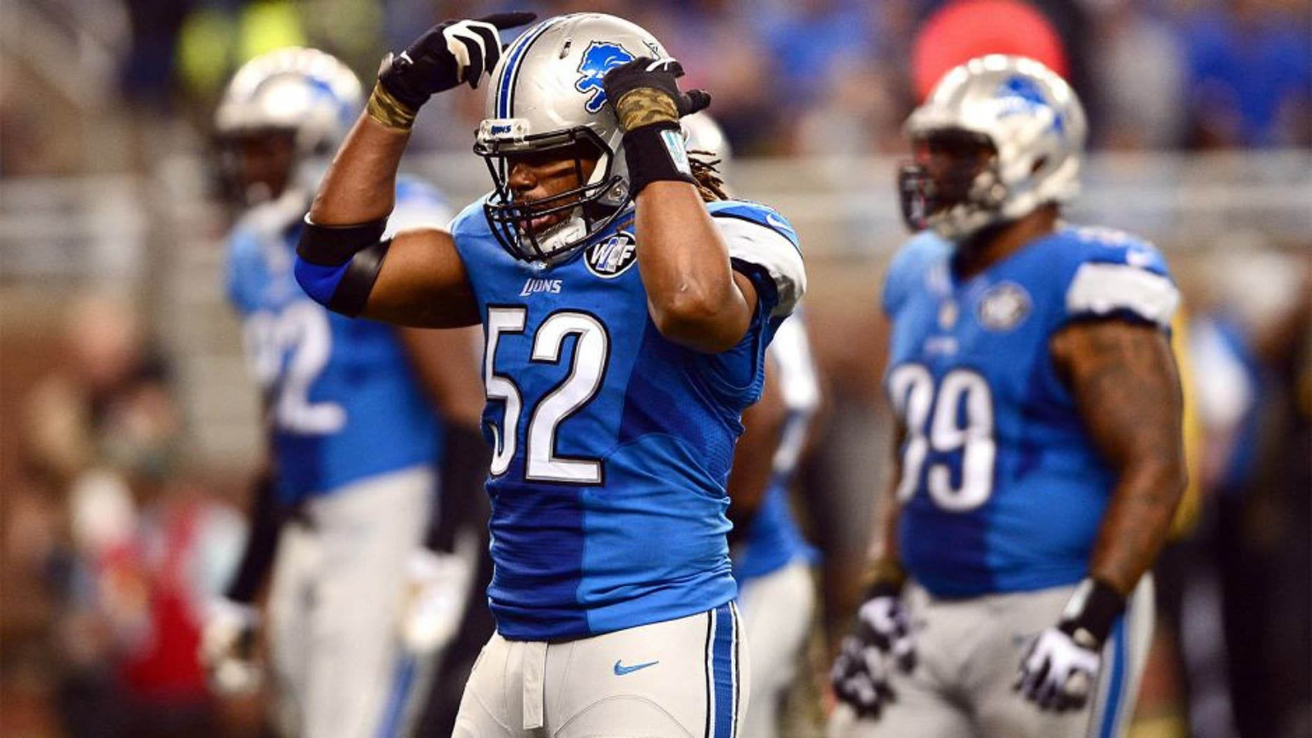 Nov 9, 2014; Detroit, MI, USA; Detroit Lions defensive end Darryl Tapp (52) against the Miami Dolphins at Ford Field. Mandatory Credit: Andrew Weber-USA TODAY Sports