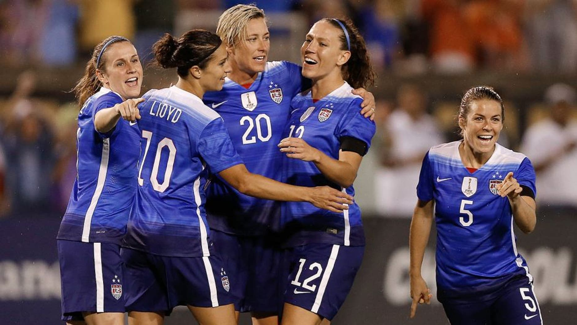 CHATTANOOGA, TN - AUGUST 19: (From left to right) Midfielder Heather O'Reilly #9, midfielder Carli Lloyd #10, forward Abby Wambach #20, midfielder Lauren Holiday #12 and defender Kelley O'Hara #5 of the United States celebrate Wambach's first half goal during the friendly match against Costa Rica at Finley Stadium on August 19, 2015 in Chattanooga, Tennessee. (Photo by Mike Zarrilli/Getty Images)