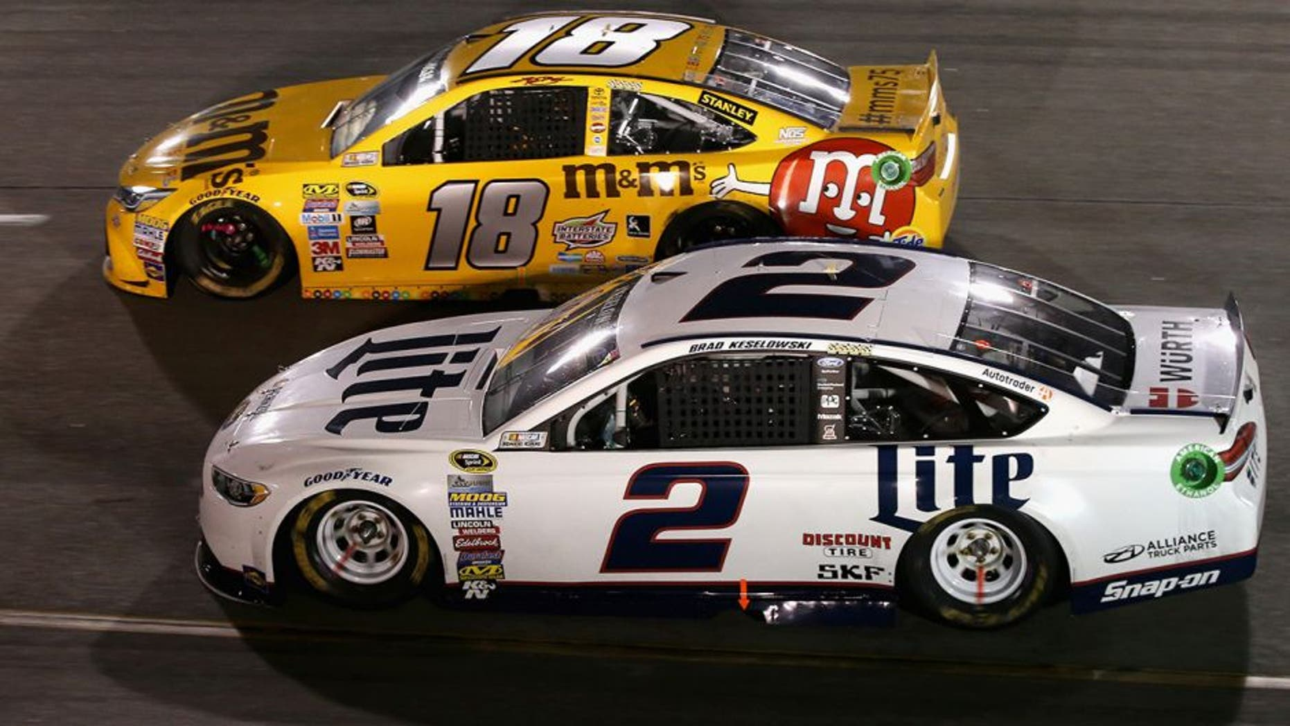 RICHMOND, VA - SEPTEMBER 10: Kyle Busch, driver of the #18 M&M's 75th Anniversary Toyota, races Brad Keselowski, driver of the #2 Miller Lite Ford, during the NASCAR Sprint Cup Series Federated Auto Parts 400 at Richmond International Raceway on September 10, 2016 in Richmond, Virginia. (Photo by Sean Gardner/Getty Images)