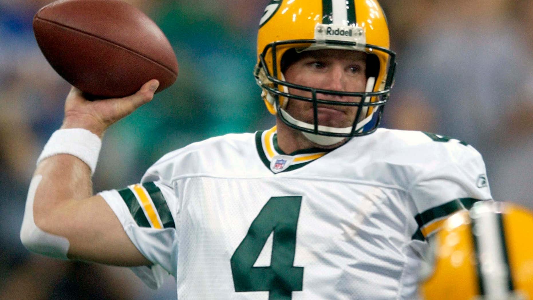 FILE - In this Sunday, Sept. 26, 2004 file photo, Green Bay Packers quarterback Brett Farve throws a pass in the first quarter against the Indianapolis Colts in Indianapolis.