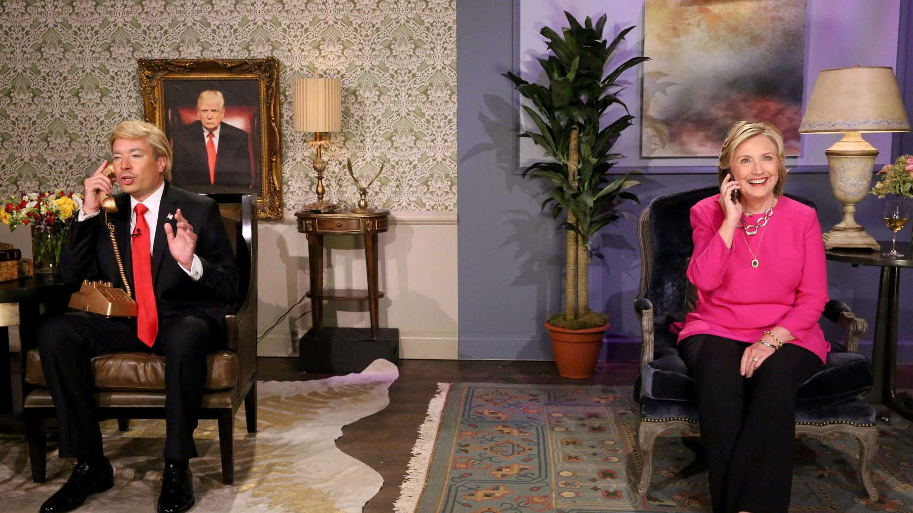 "In this image released by NBC, host Jimmy Fallon, portraying Donald Trump, left, and Hillary Rodham Clinton appear during a skit titled, ""Trump calls Hillary"" during a taping of ""The Tonight Show Starring Jimmy Fallon,"" on Wednesday, Sept. 16, 2015, in New York."