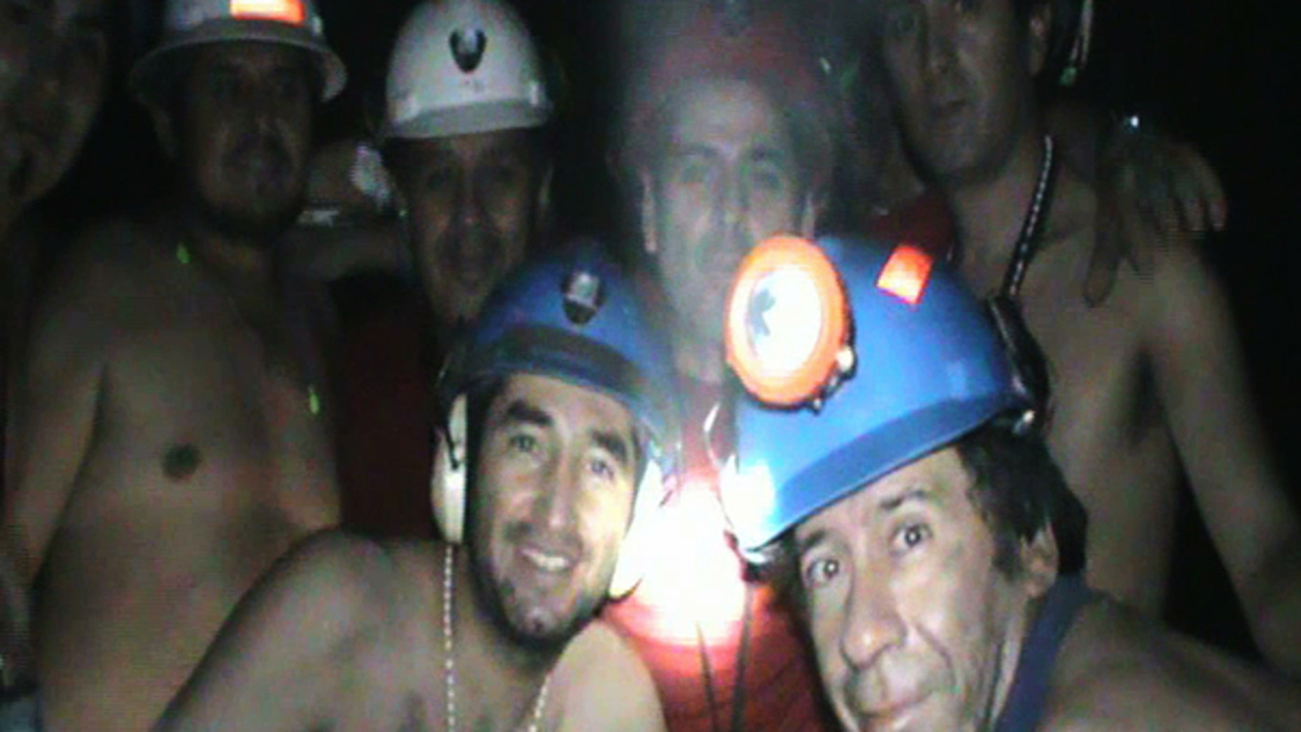 Sept. 17: In this TV grab taken from a video released by Chile's Presidency, trapped miners celebrate inside the San Jose mine in Copiapo, Chile. Drilling equipment pounded its way into one of the caverns where 33 miners have been trapped for a month and a half, completing a bore hole ahead of schedule and raising hopes that the men can be pulled out earlier than expected.