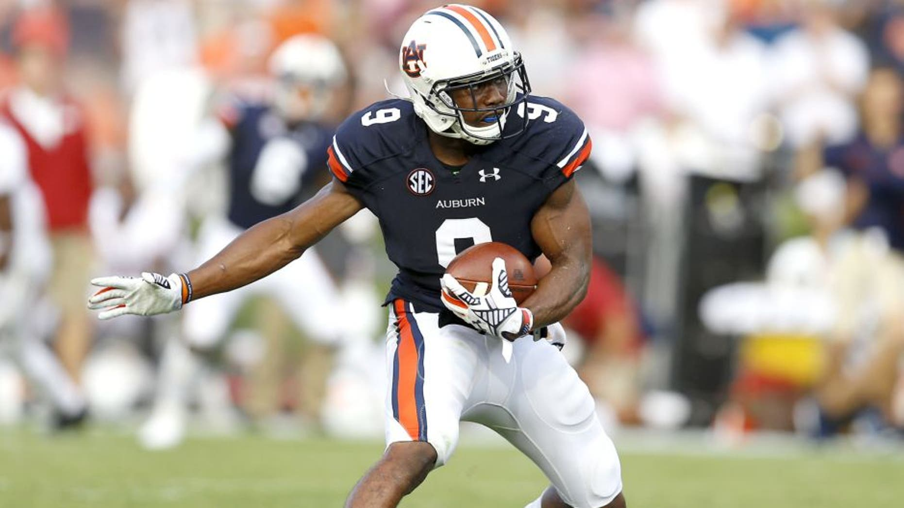 AUBURN, AL - AUGUST 30: Defensive back Jermaine Whitehead #9 of the Auburn Tigers intercepts a pass during the game against the Arkansas Razorbacks at Jordan Hare Stadium on August 30, 2014 in Auburn, Alabama. (Photo by Mike Zarrilli/Getty Images)