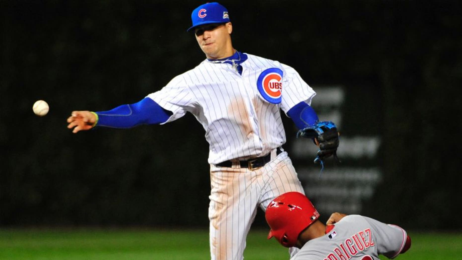 Chicago Cubs shortstop Javier Baez, left, forces out Cincinnati Reds' Yorman Rodriguez (33) at second base during the fourth inning of a baseball game, Wednesday, Sept. 17, 2014 in Chicago. (AP Photo/David Banks)