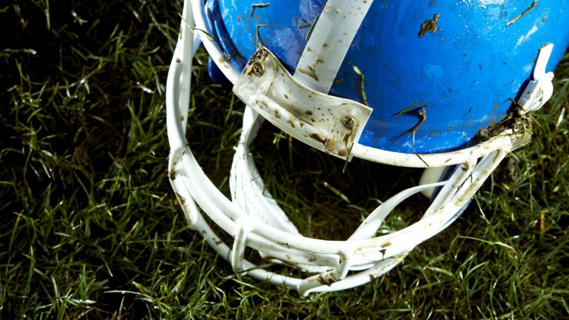 Football helmet on grass
