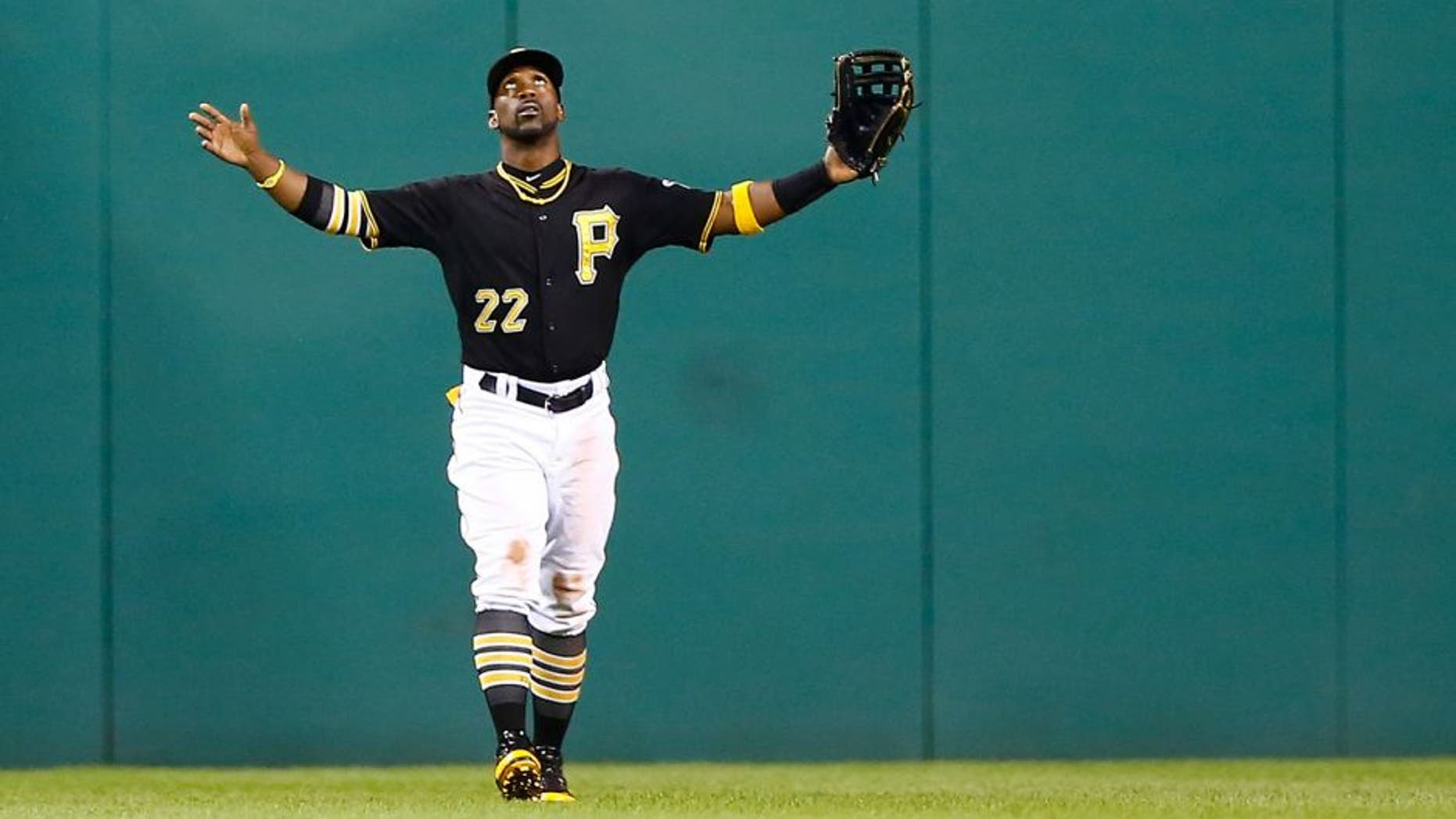 PITTSBURGH, PA - SEPTEMBER 11: Andrew McCutchen #22 of the Pittsburgh Pirates celebrates their 6-3 win against the Milwaukee Brewers during the game at PNC Park on September 11, 2015 in Pittsburgh, Pennsylvania. (Photo by Jared Wickerham/Getty Images)
