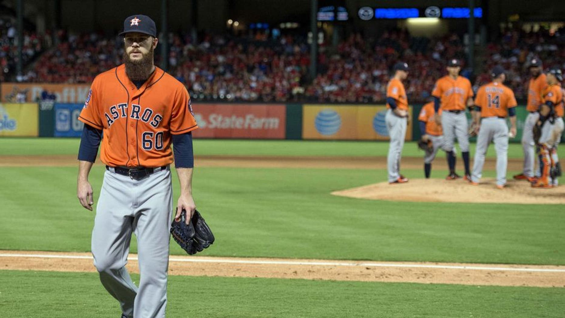 Sep 16, 2015; Arlington, TX, USA; Houston Astros starting pitcher Dallas Keuchel (60) leaves the game during the fifth inning against the Texas Rangers at Globe Life Park in Arlington. The Rangers defeat the Astros 14-3. Mandatory Credit: Jerome Miron-USA TODAY Sports