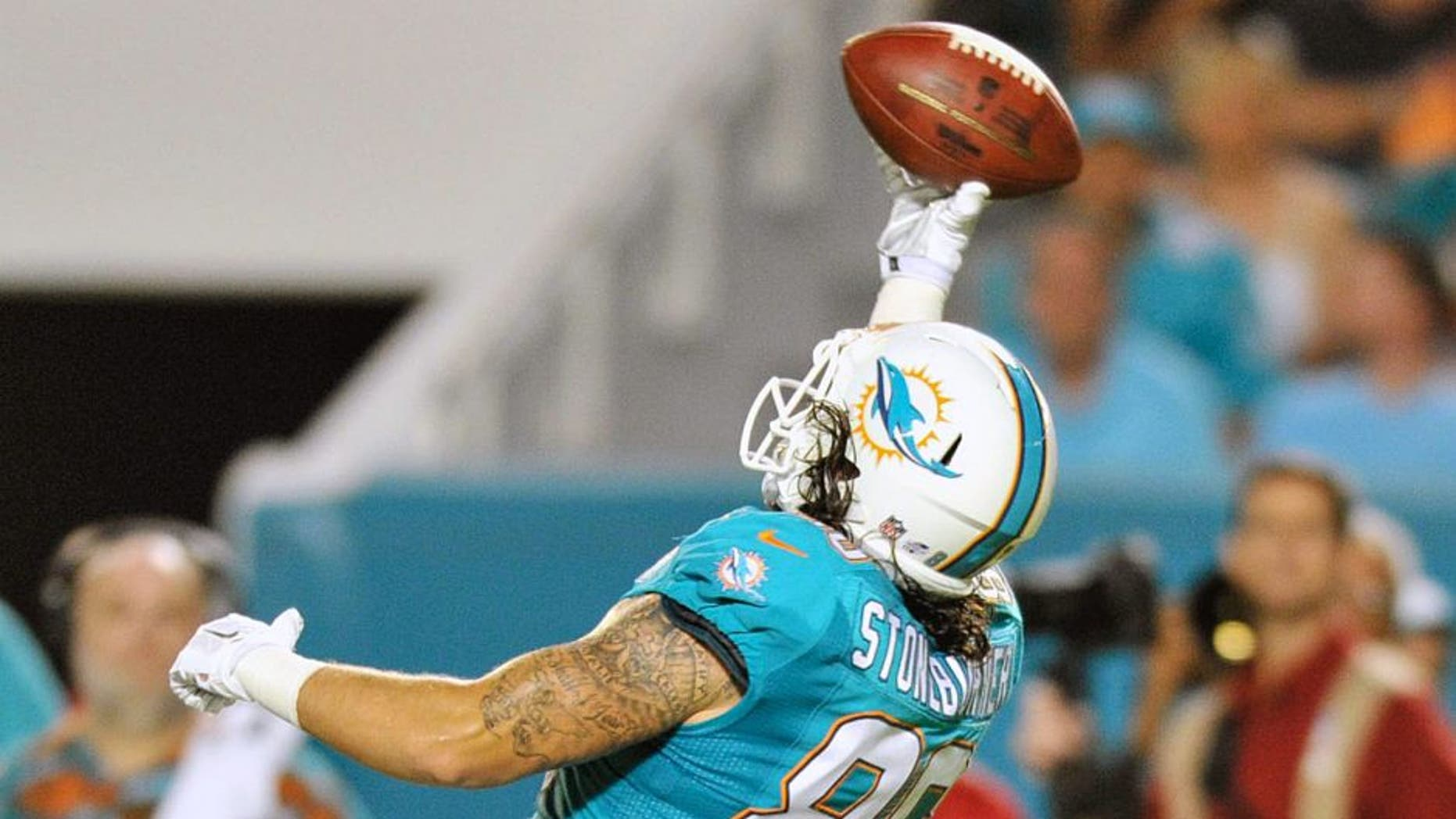 Sep 3, 2015; Miami Gardens, FL, USA; Miami Dolphins tight end Jake Stoneburner (86) is unable to makes a catch during the second half against the Miami Dolphins at Sun Life Stadium. Mandatory Credit: Steve Mitchell-USA TODAY Sports