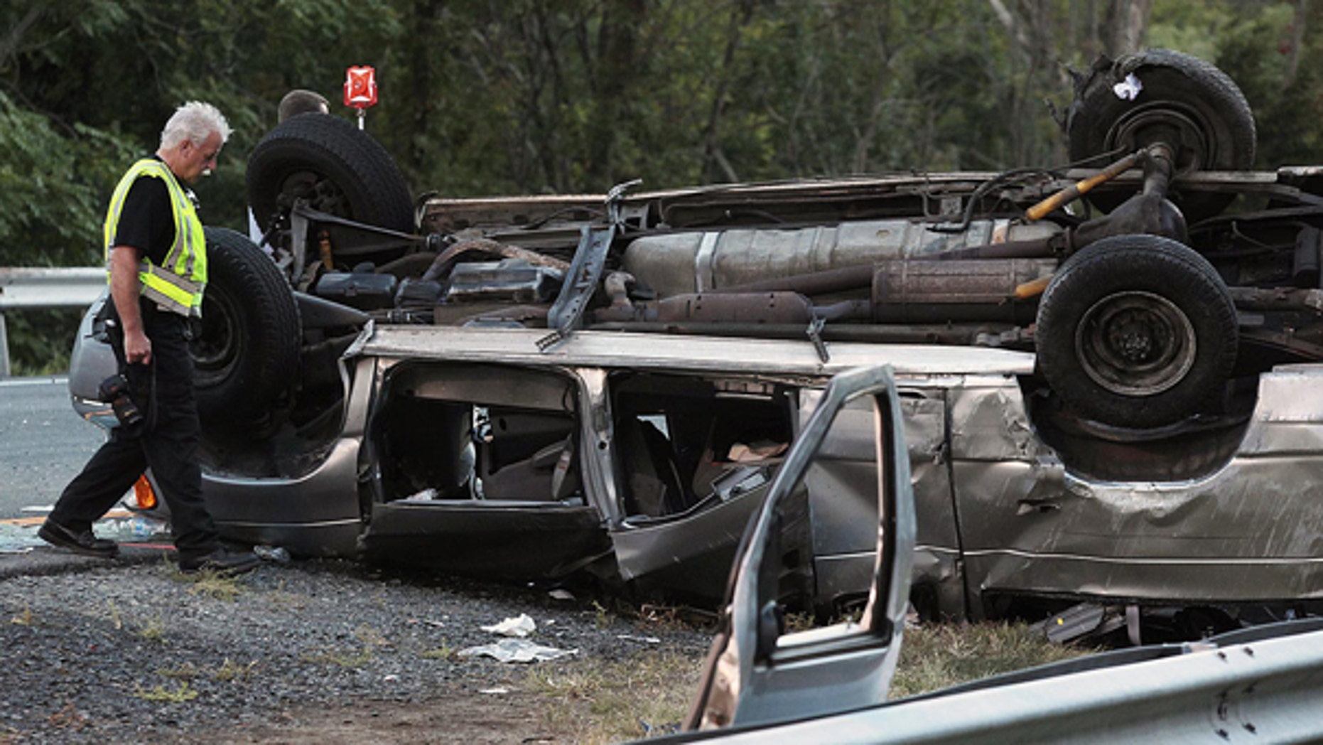 Sept. 18: State police investigate the scene of a fatal accident in Woodbury, N.Y. A passenger van carrying members of a church flipped over killing at least six people and injuring eight others, authorities said.