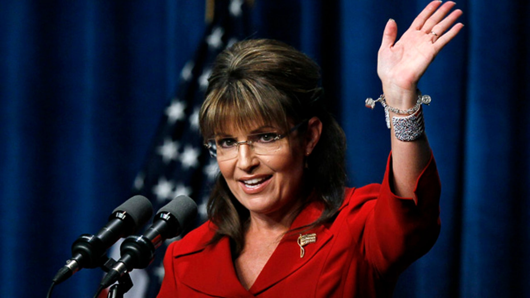 Sept. 17: Former Alaska Gov. Sarah Palin waves after speaking at the Republican Party of Iowa's Ronald Reagan Dinner in Des Moines, Iowa.