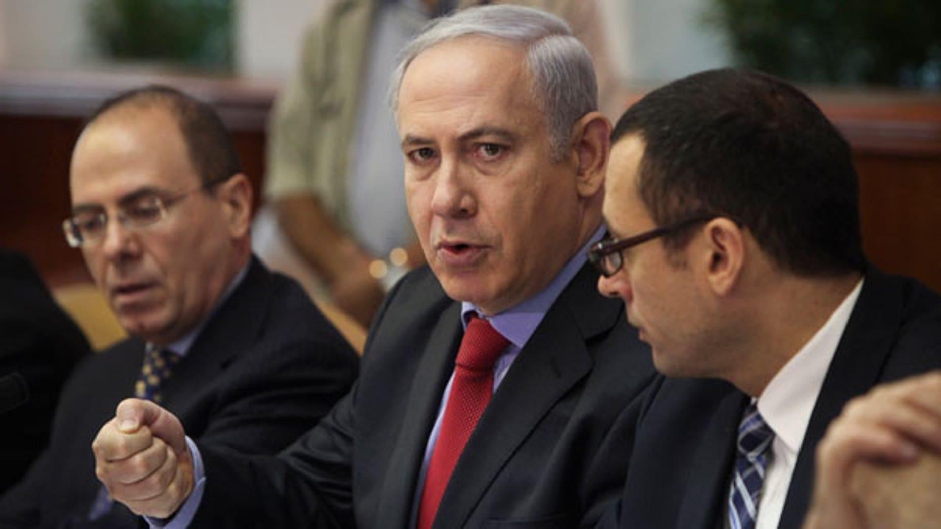 Sept. 18: Israeli Prime Minister Benjamin Netanyahu, center, talks during a weekly cabinet meeting in Jerusalem.