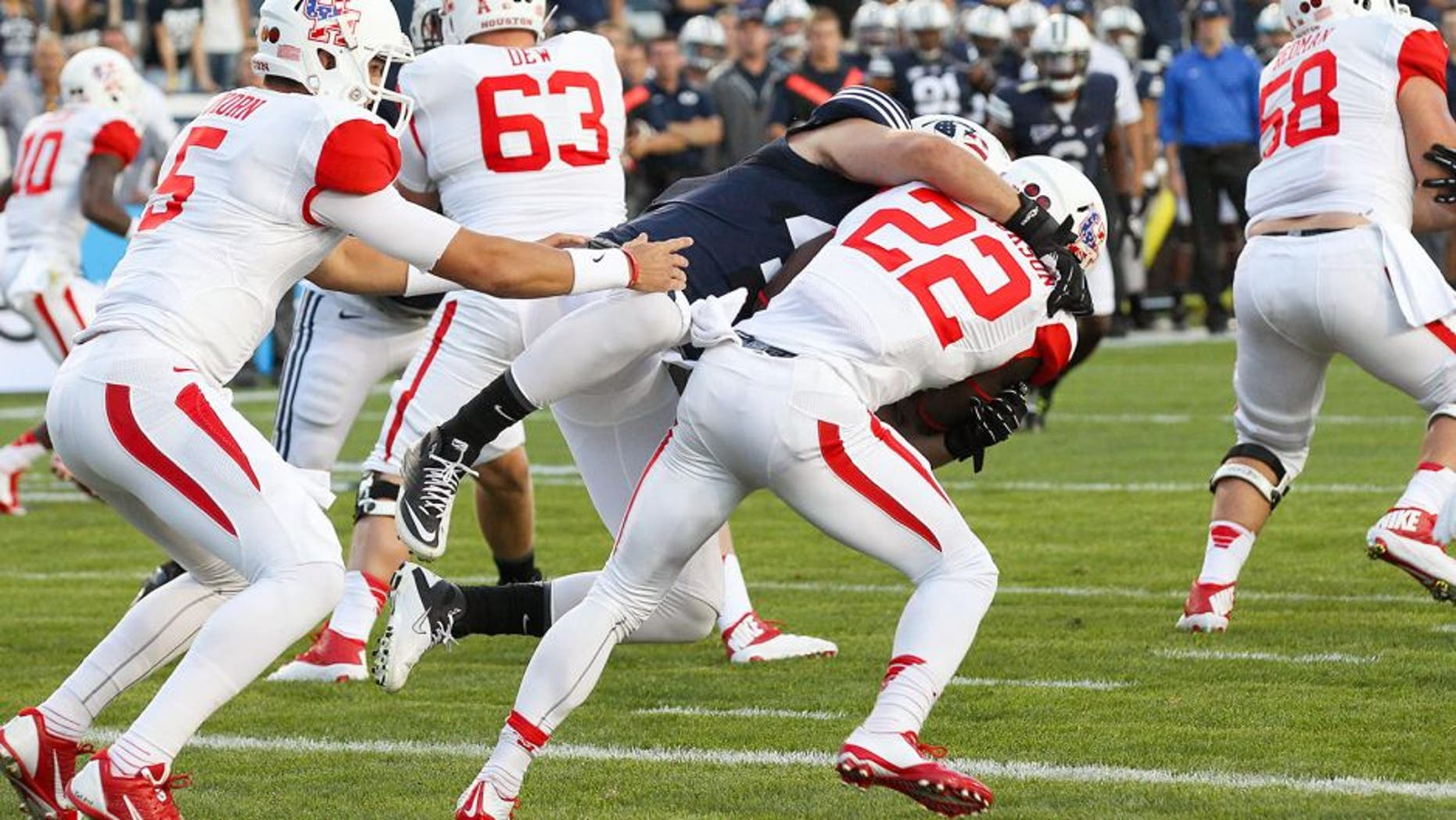 Sep 11, 2014; Provo, UT, USA; Brigham Young Cougars linebacker Zac Stout (47) tackles Houston Cougars running back Ryan Jackson (22) in the end zone and gets a safety during the first quarter at Lavell Edwards Stadium. Mandatory Credit: Chris Nicoll-USA TODAY Sports