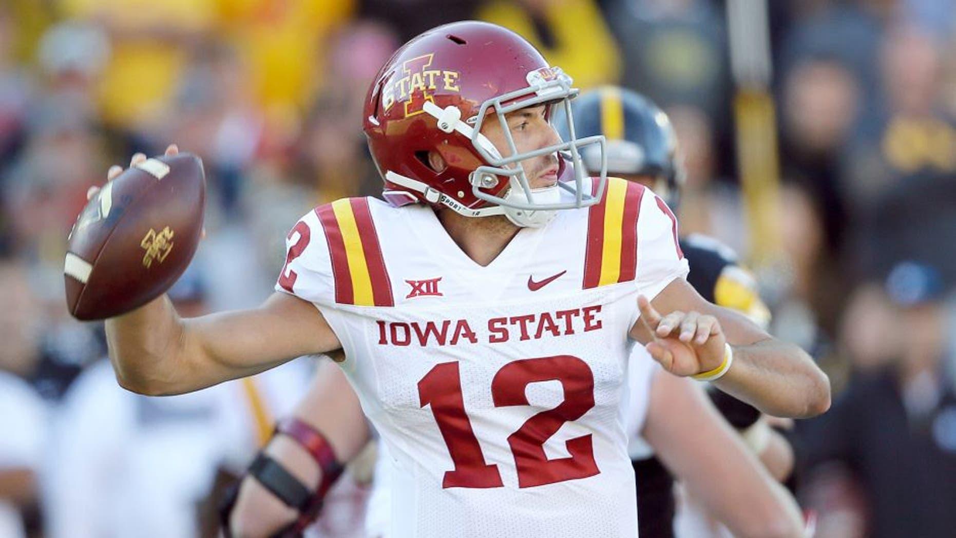Iowa State quarterback Sam B. Richardson throws a pass during the second half of an NCAA college football game against Iowa, Saturday, Sept. 13, 2014, in Iowa City, Iowa. Iowa State won 20-17. (AP Photo/Charlie Neibergall)