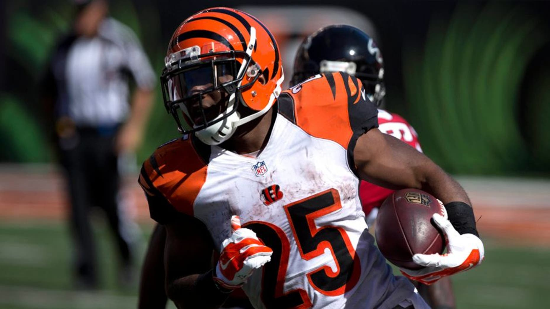 Sep 14, 2014; Cincinnati, OH, USA; Cincinnati Bengals running back Giovani Bernard (25) carries the ball in the second half against the Atlanta Falcons at Paul Brown Stadium. The Bengals won 24-10. Mandatory Credit: Aaron Doster-USA TODAY Sports