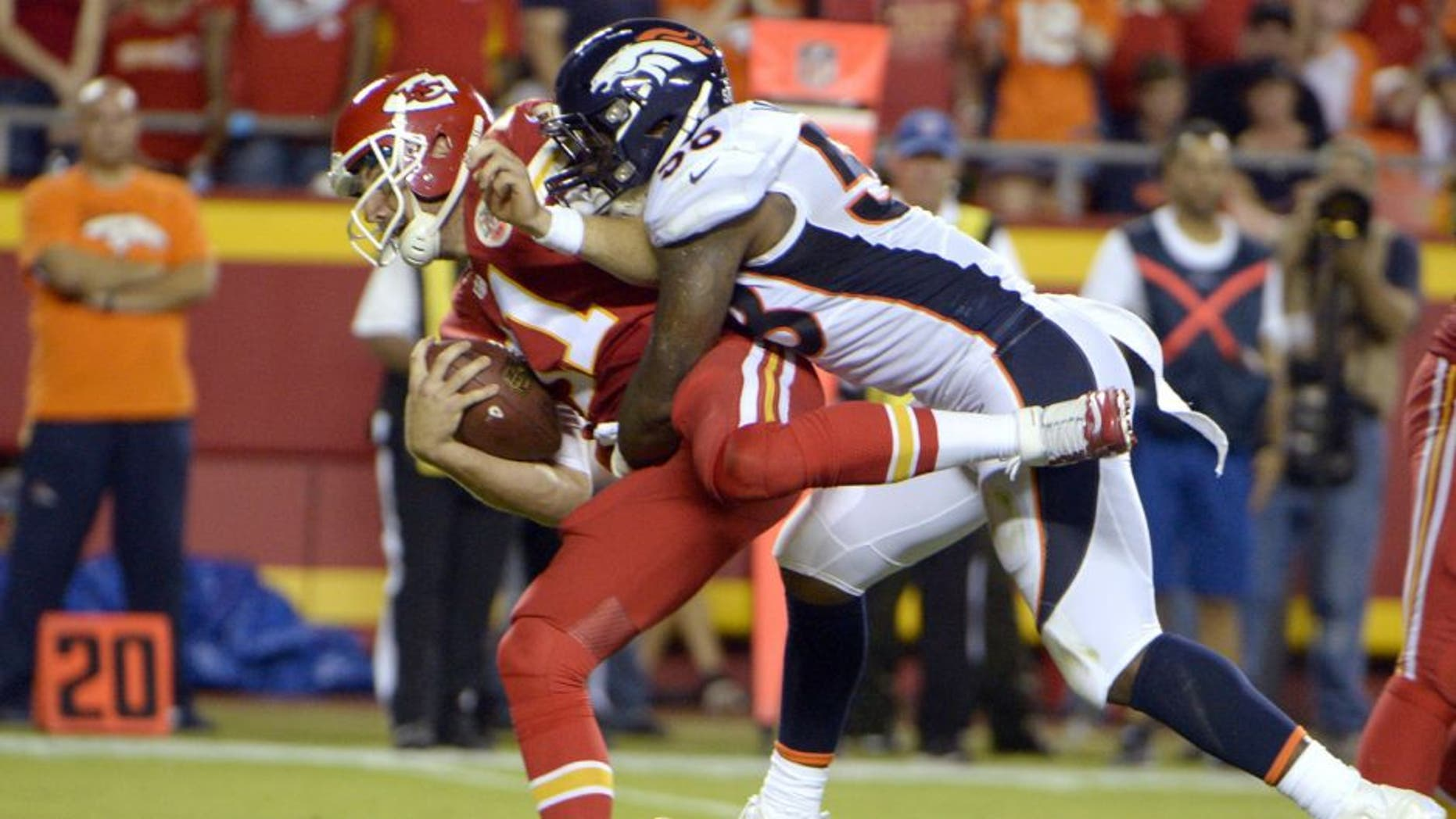 Sep 17, 2015; Kansas City, MO, USA; Denver Broncos outside linebacker Von Miller (58) is penalized for hitting Kansas City Chiefs quarterback Alex Smith (11) in the first half at Arrowhead Stadium. Mandatory Credit: John Rieger-USA TODAY Sports
