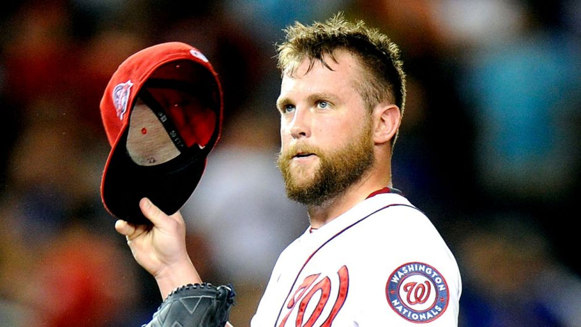 WASHINGTON, DC - SEPTEMBER 08: Drew Storen #22 of the Washington Nationals reacts after walking in a run in the seventh inning against the New York Mets at Nationals Park on September 8, 2015 in Washington, DC. New York won the game 8-7. (Photo by Greg Fiume/Getty Images)