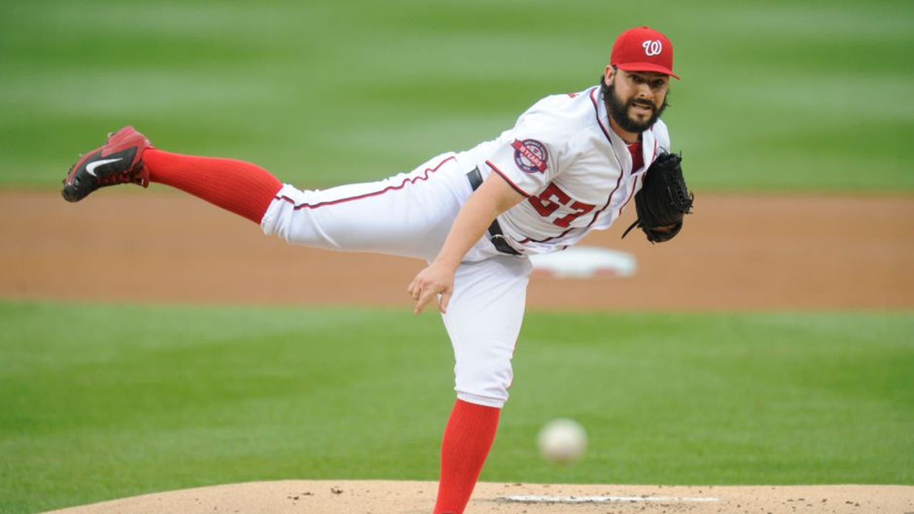 WASHINGTON, DC - JUNE 05: Tanner Roark #57 of the Washington Nationals pitches during a baseball game against the Chicago Cubs at Nationals Park on June 5, 2015 in Washington, DC. The Nationals won 7-5. (Photo by Mitchell Layton/Getty Images)