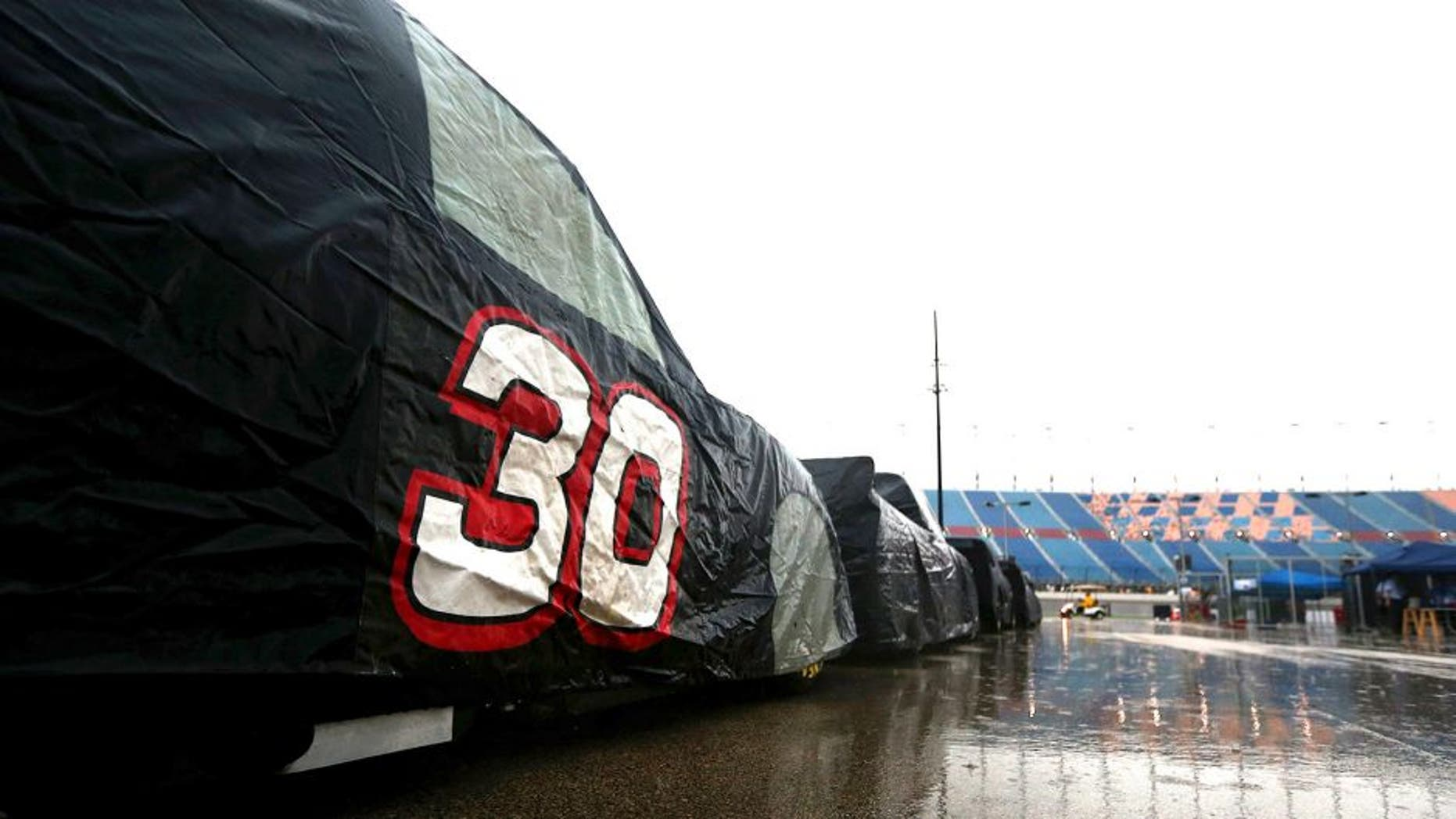 JOLIET, IL - SEPTEMBER 18: A view of pit road during heavy rain during qualifying for the NASCAR Camping World Truck Series American Ethanol E15 225 at Chicagoland Speedway on September 18, 2015 in Joliet, Illinois. (Photo by Sarah Crabill/NASCAR via Getty Images)