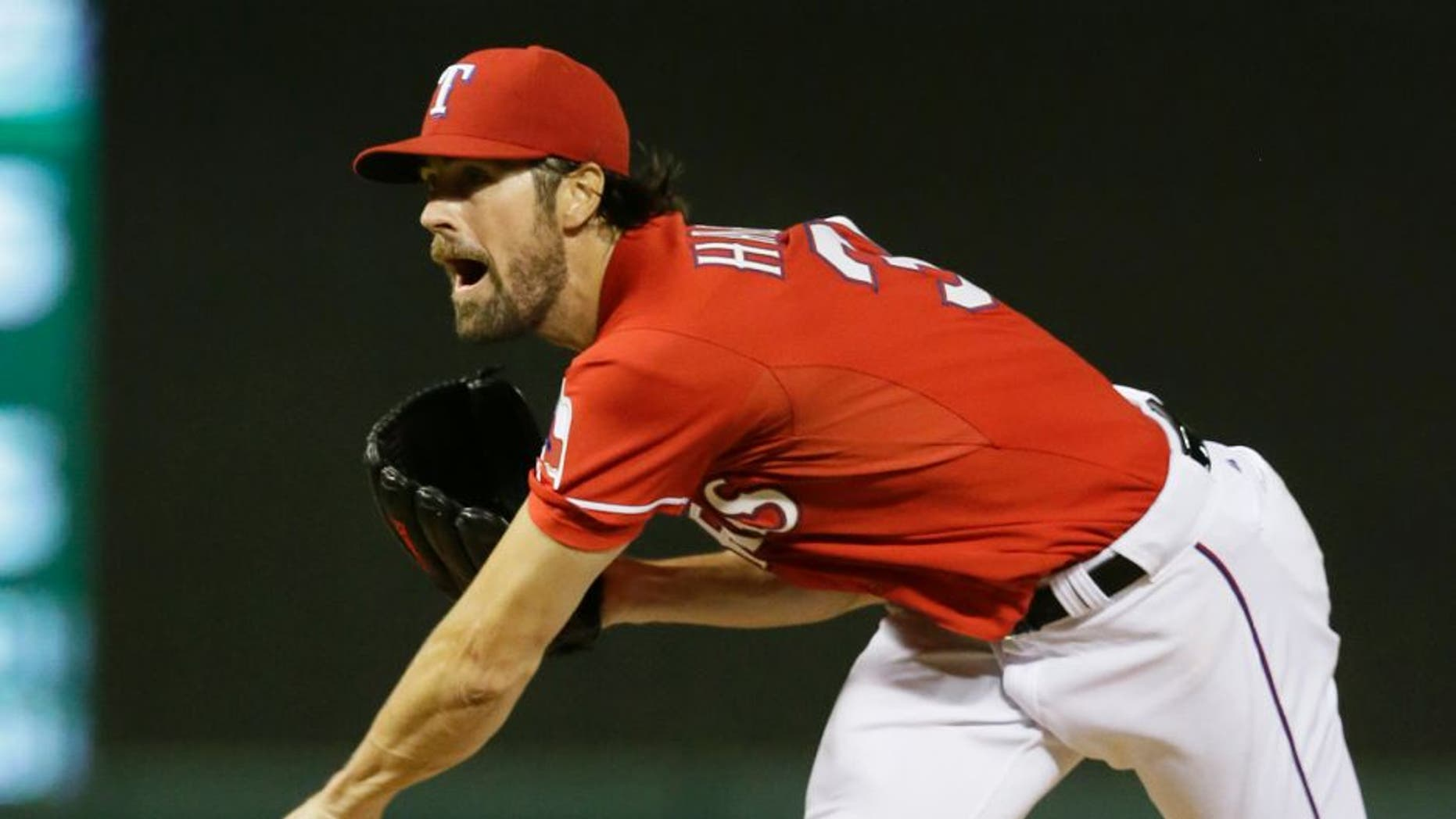 Texas Rangers starter Cole Hamels reacts after releasing a pitch during the seventh inning of a baseball game against the Texas Rangers in Arlington, Texas, Saturday, Sept. 19, 2015. The Rangers won 10-1. (AP Photo/LM Otero)
