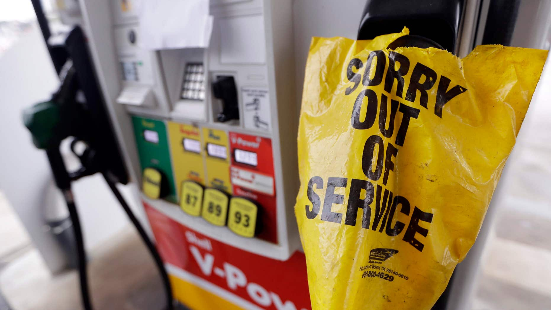 A bag covers a pump handle at a gas station that has no fuel to sell Saturday, Sept. 17, 2016, in Nashville, Tenn.