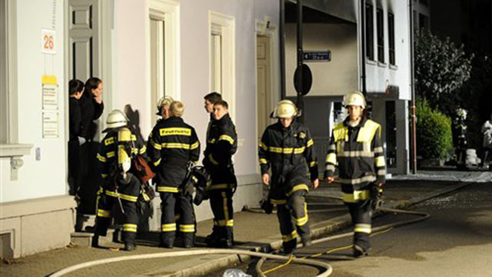 Sept. 19: Firefighters stand in front of a house where an explosion occured in Loerrach, southern Germany.