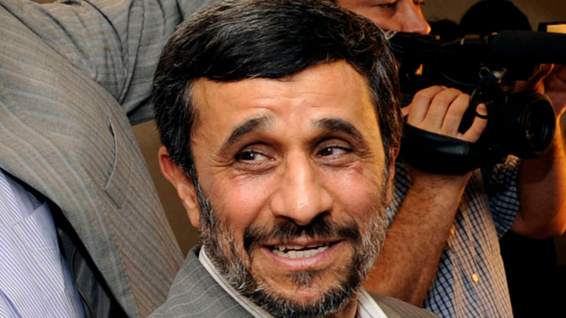 The report specifically names Iranian President Mahmoud Ahmadinejad as a violator of religious freedom. (AP)