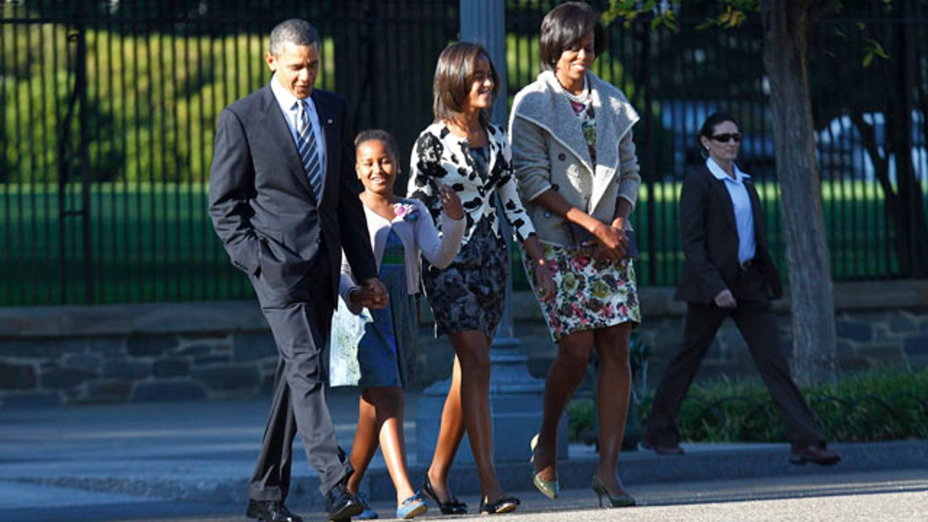 Sept. 19: President Obama, first lady Michelle Obama, and daughters, from left, Sasha and Malia walk from the White House across Pennyslvania Avenue to service at St. John's Episcopal Church in Washington.