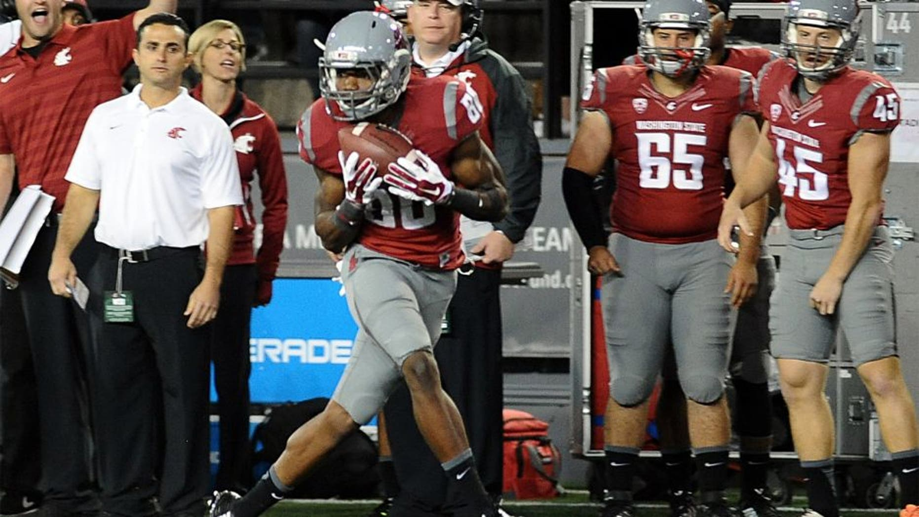 Sep 13, 2014; Pullman, WA, USA; Washington State Cougars wide receiver Dom Williams (80) makes a catch that would turn into a touchdown against the Portland State Vikings during the second half at Martin Stadium. The Cougar beat Vikings 59-21. Mandatory Credit: James Snook-USA TODAY Sports