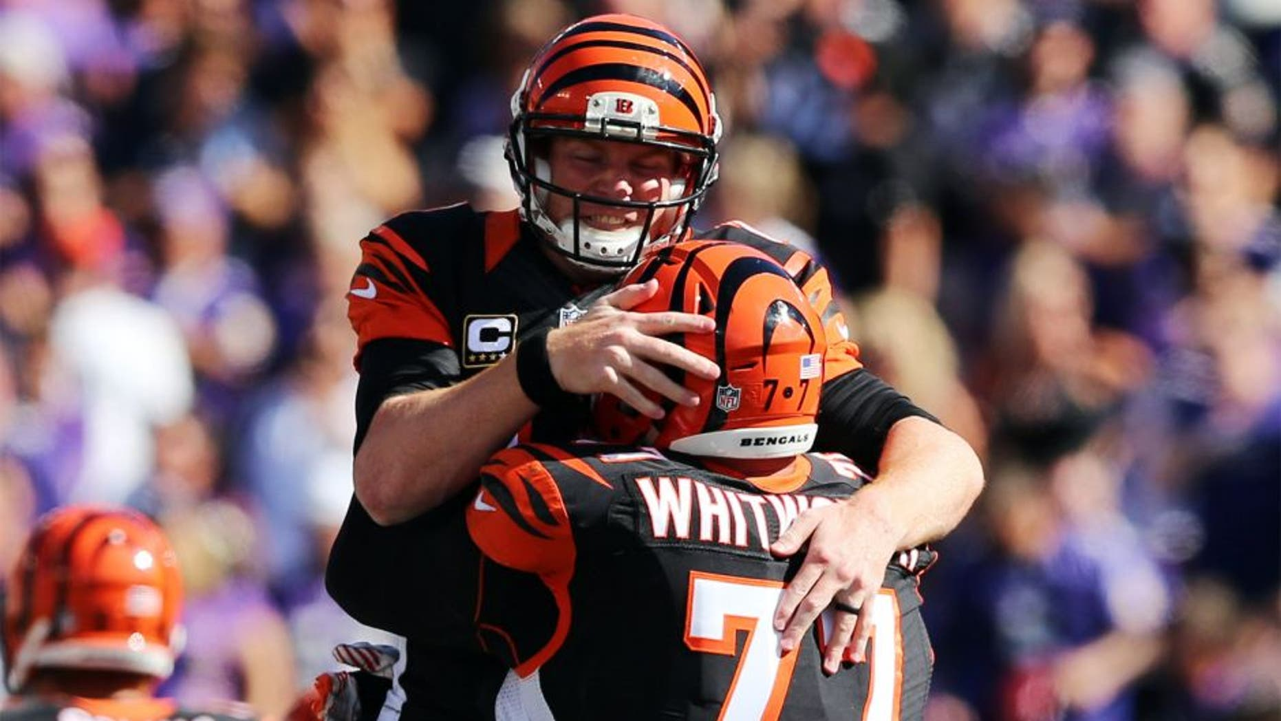 Sep 7, 2014; Baltimore, MD, USA; Cincinnati Bengals quarterback Andy Dalton (14) celebrates his last touchdown pass with tackle Andrew Whitworth (77) against the Baltimore Ravens at M&T Bank Stadium. Mandatory Credit: Mitch Stringer-USA TODAY Sports