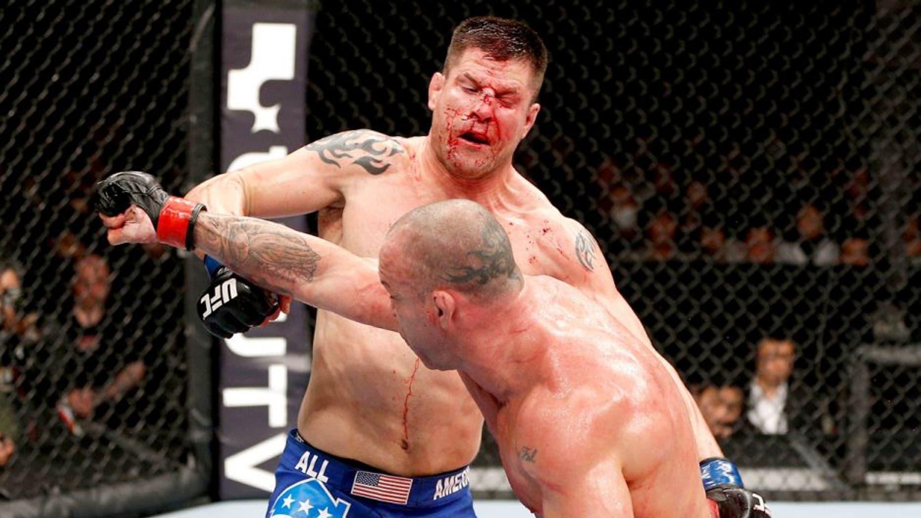 SAITAMA, JAPAN - MARCH 03: (R-L) Wanderlei Silva punches Brian Stann in their light heavyweight fight during the UFC on FUEL TV event at Saitama Super Arena on March 3, 2013 in Saitama, Japan. (Photo by Josh Hedges/Zuffa LLC/Zuffa LLC via Getty Images)