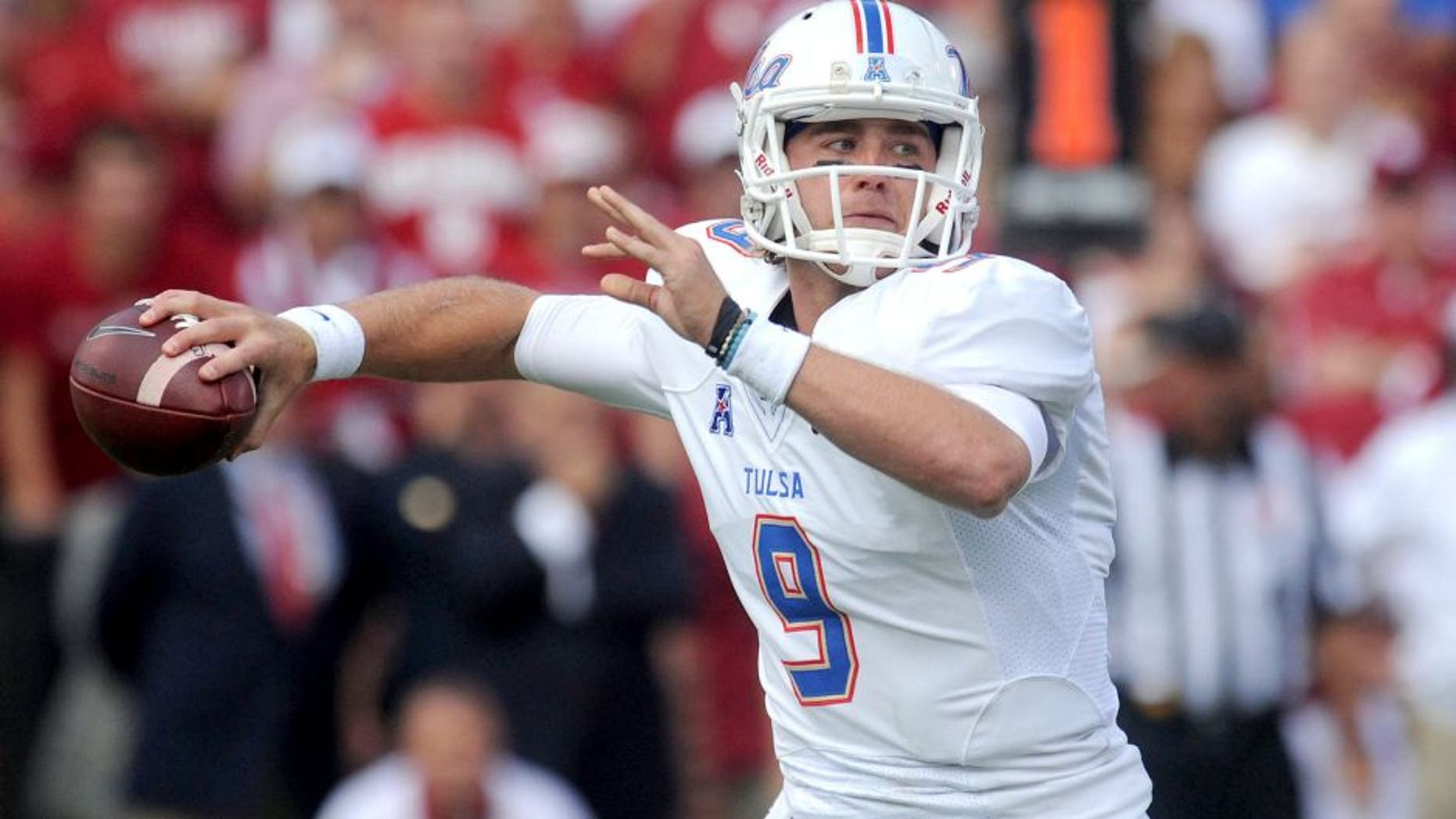 Sep 19, 2015; Norman, OK, USA; Tulsa Golden Hurricane quarterback Dane Evans (9) passes the ball against the Oklahoma Sooners in the fist quarter at Gaylord Family - Oklahoma Memorial Stadium. Mandatory Credit: Mark D. Smith-USA TODAY Sports