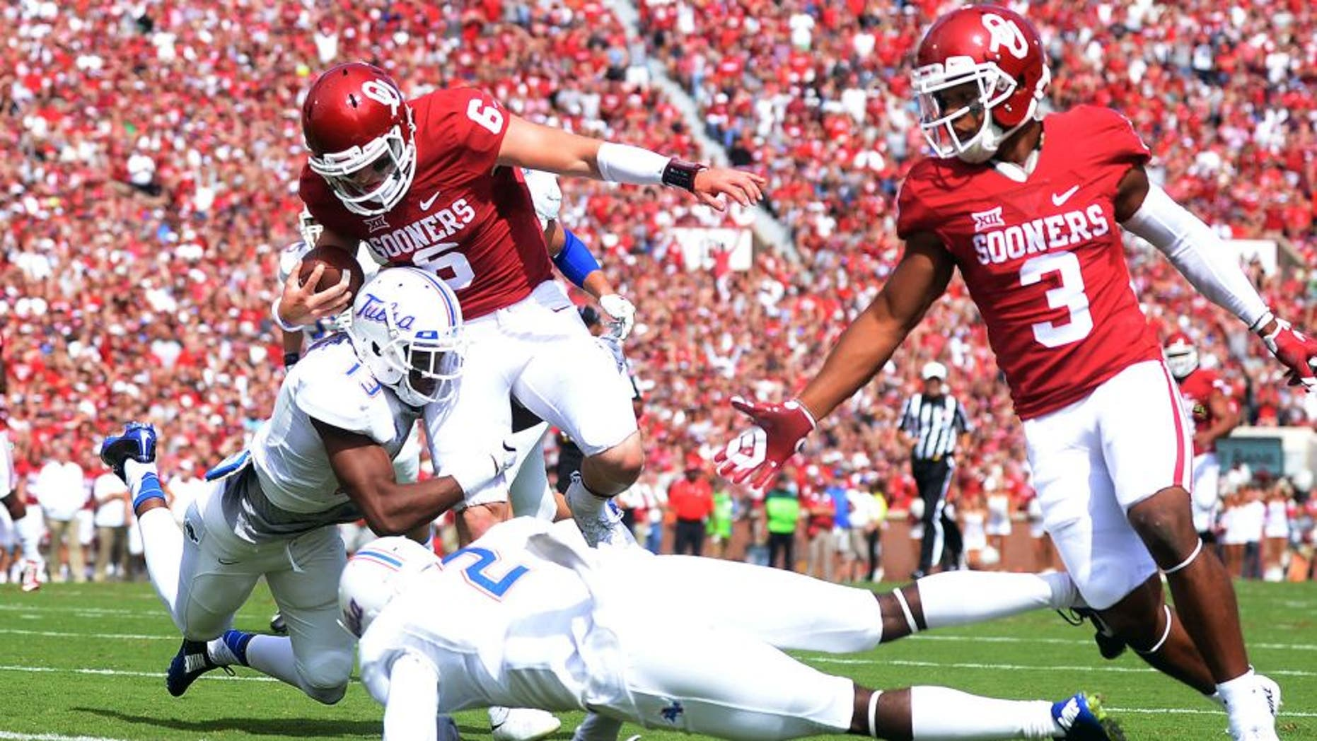 Sep 19, 2015; Norman, OK, USA;Oklahoma Sooners quarterback Baker Mayfield (6) runs for a touchdown against the Tulsa Golden Hurricane during the first quarter at Gaylord Family - Oklahoma Memorial Stadium. Mandatory Credit: Mark D. Smith-USA TODAY Sports