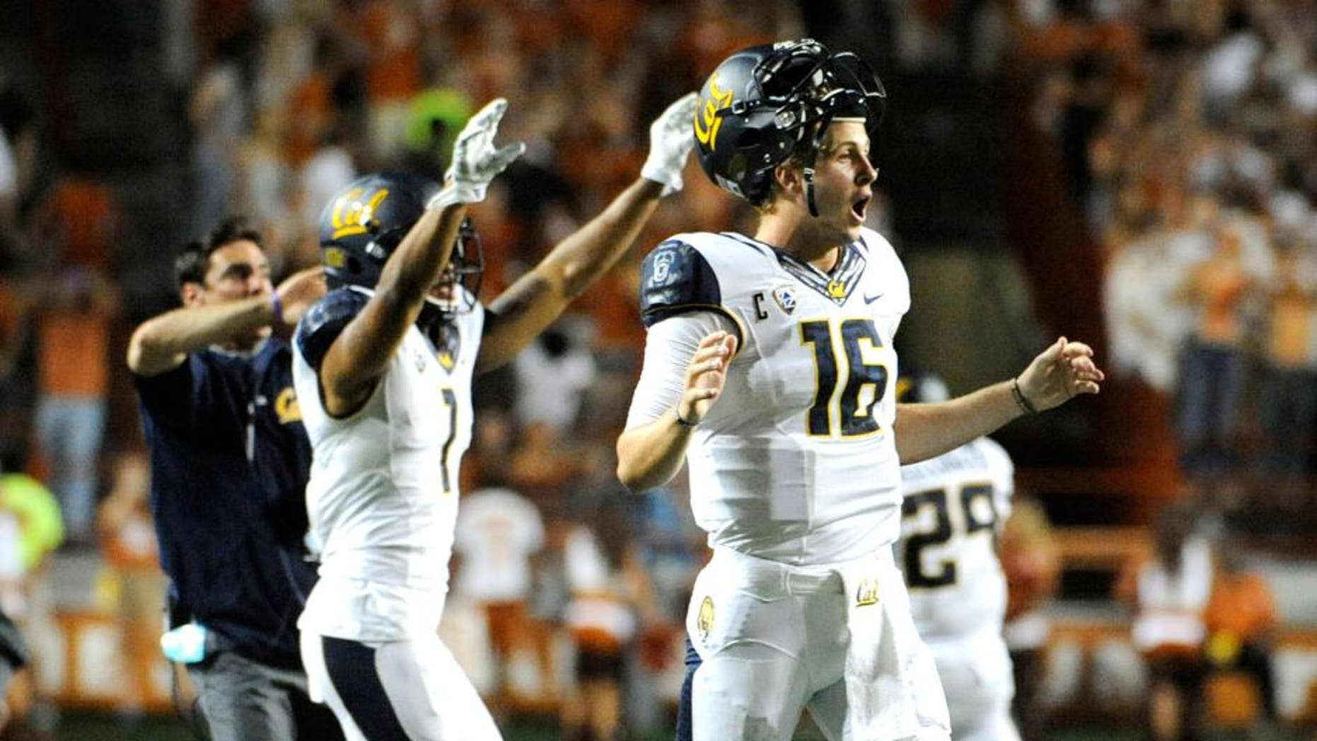 Sep 19, 2015; Austin, TX, USA; California Golden Bears quarterback Jared Goff (16) and wide receiver Bryce Treggs (1) react after the Texas Longhorns miss an extra point that would tie the game at 45 during the fourth quarter at Darrell K Royal-Texas Memorial Stadium. Cal beat Texas 45-44. Mandatory Credit: Brendan Maloney-USA TODAY Sports
