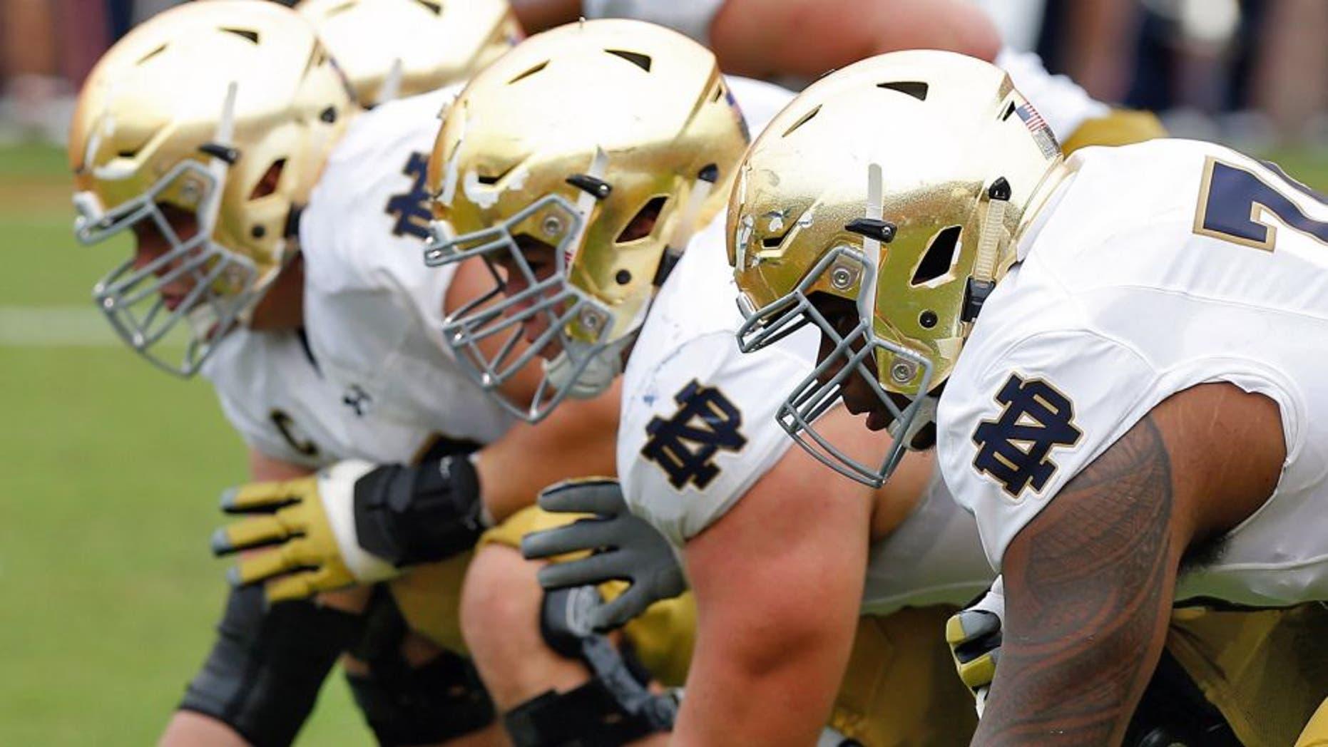 Sep 12, 2015; Charlottesville, VA, USA; The Notre Dame Fighting Irish offensive line lines up against the Virginia Cavaliers at Scott Stadium. Mandatory Credit: Geoff Burke-USA TODAY Sports