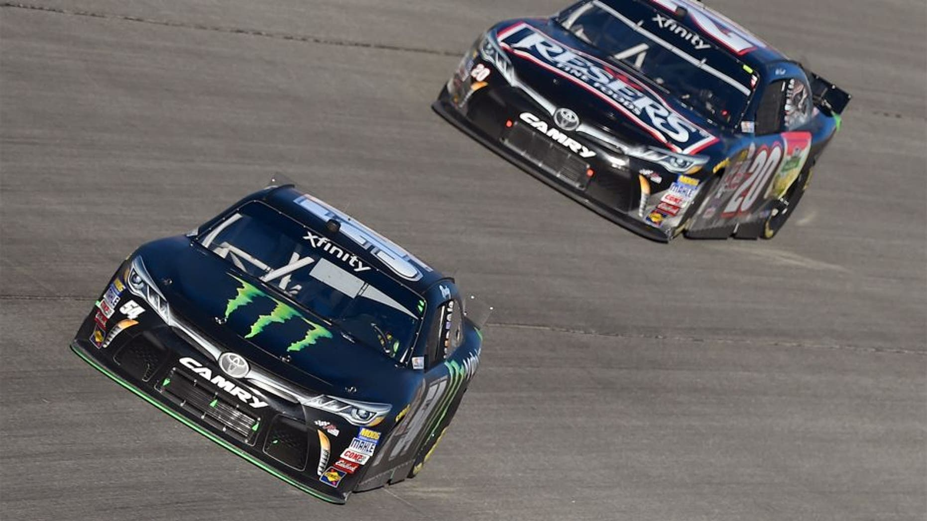 JOLIET, IL - SEPTEMBER 19: Kyle Busch, driver of the #54 Monster Energy Toyota, leads Matt Kenseth, driver of the #20 Reser's Main Street Toyota, during the NASCAR XFINITY Series FURIOUS 7 300 at Chicagoland Speedway on September 19, 2015 in Joliet, Illinois. (Photo by Josh Hedges/Getty Images)