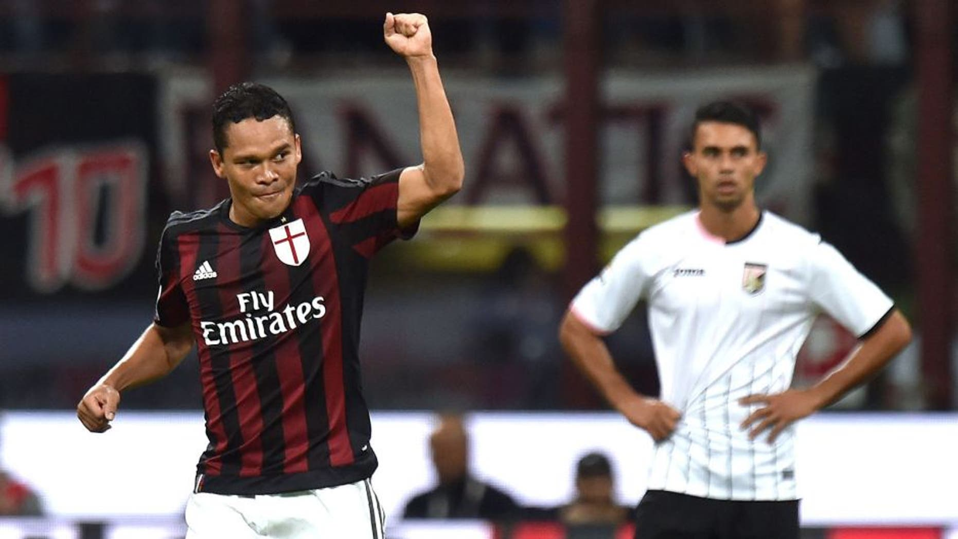 MILAN, ITALY - SEPTEMBER 19: Carlos Bacca (L) of Milan celebrates after scoring the opening goal during the Serie A match between AC Milan and US Citta di Palermo at Stadio Giuseppe Meazza on September 19, 2015 in Milan, Italy. (Photo by Tullio M. Puglia/Getty Images)