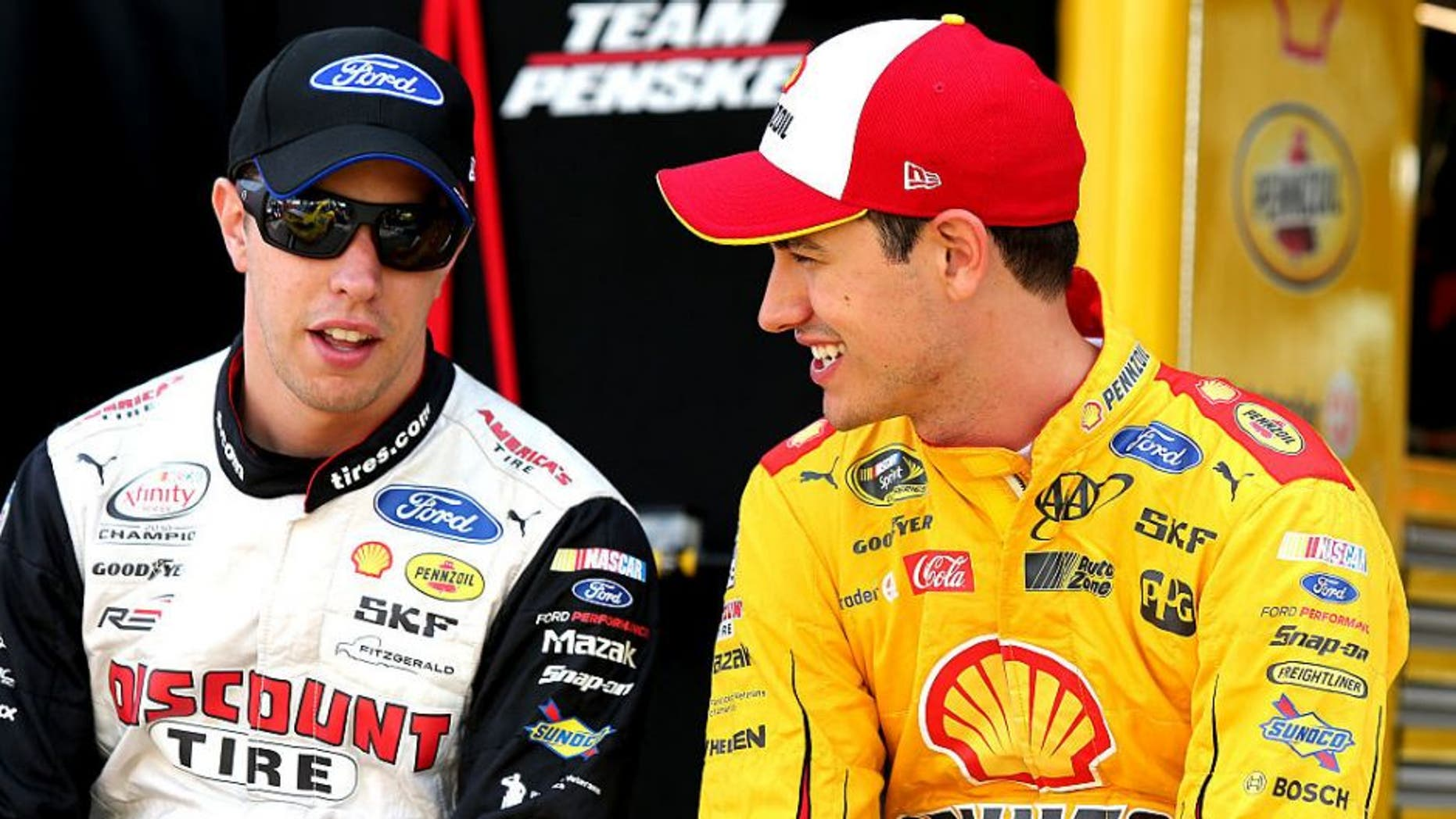 BRISTOL, TN - AUGUST 19: Brad Keselowski, driver of the #2 Autotrader Ford, talks to Joey Logano, driver of the #22 Shell Pennzoil Ford, on the grid during qualifying for the NASCAR Sprint Cup Series Bass Pro Shops NRA Night Race at Bristol Motor Speedway on August 19, 2016 in Bristol, Tennessee. (Photo by Jerry Markland/Getty Images)