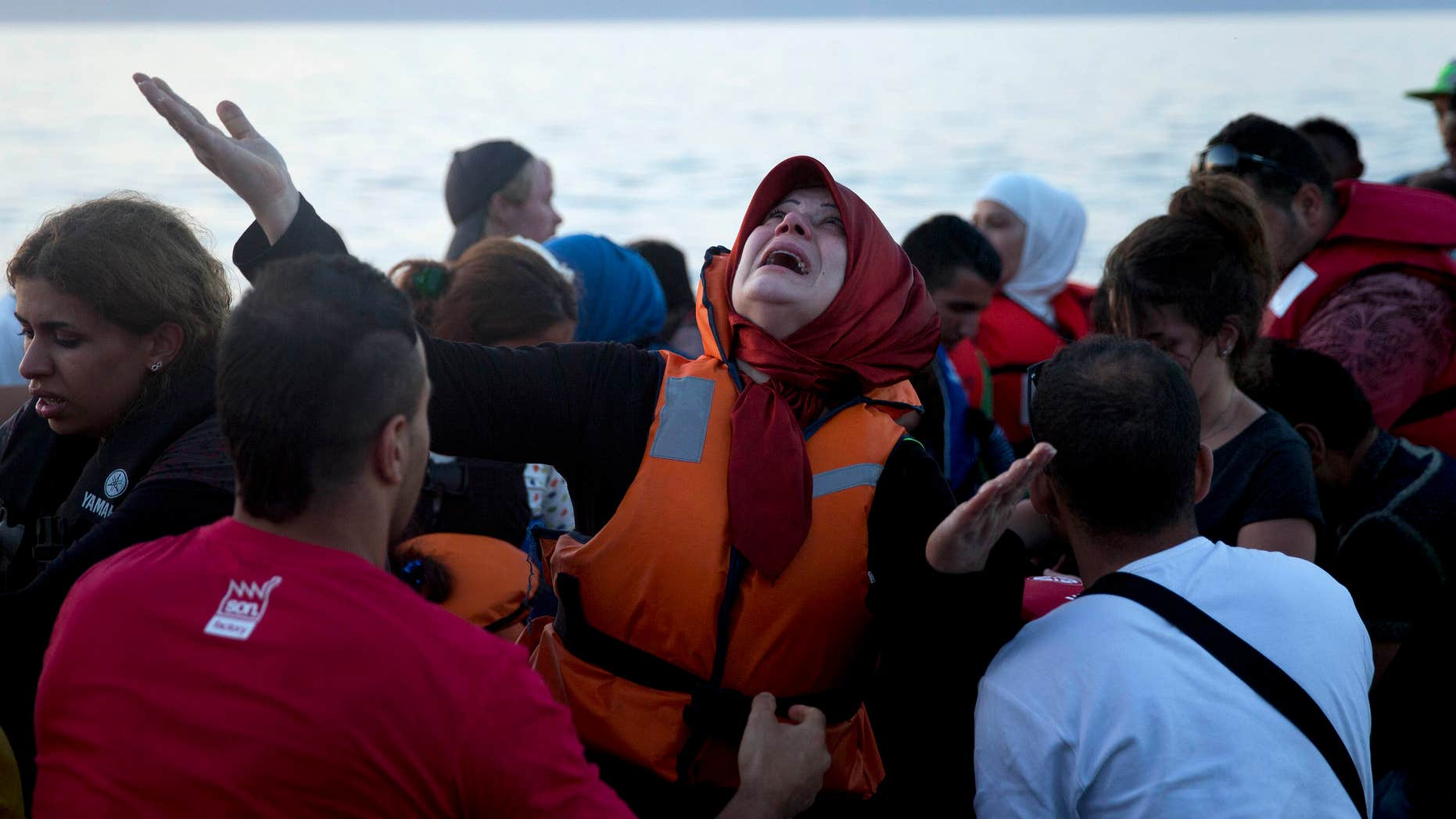 Sept. 19, 2015: A woman reacts as she arrives aboard a dinghy after crossing from Turkey, to the island of Lesbos, Greece
