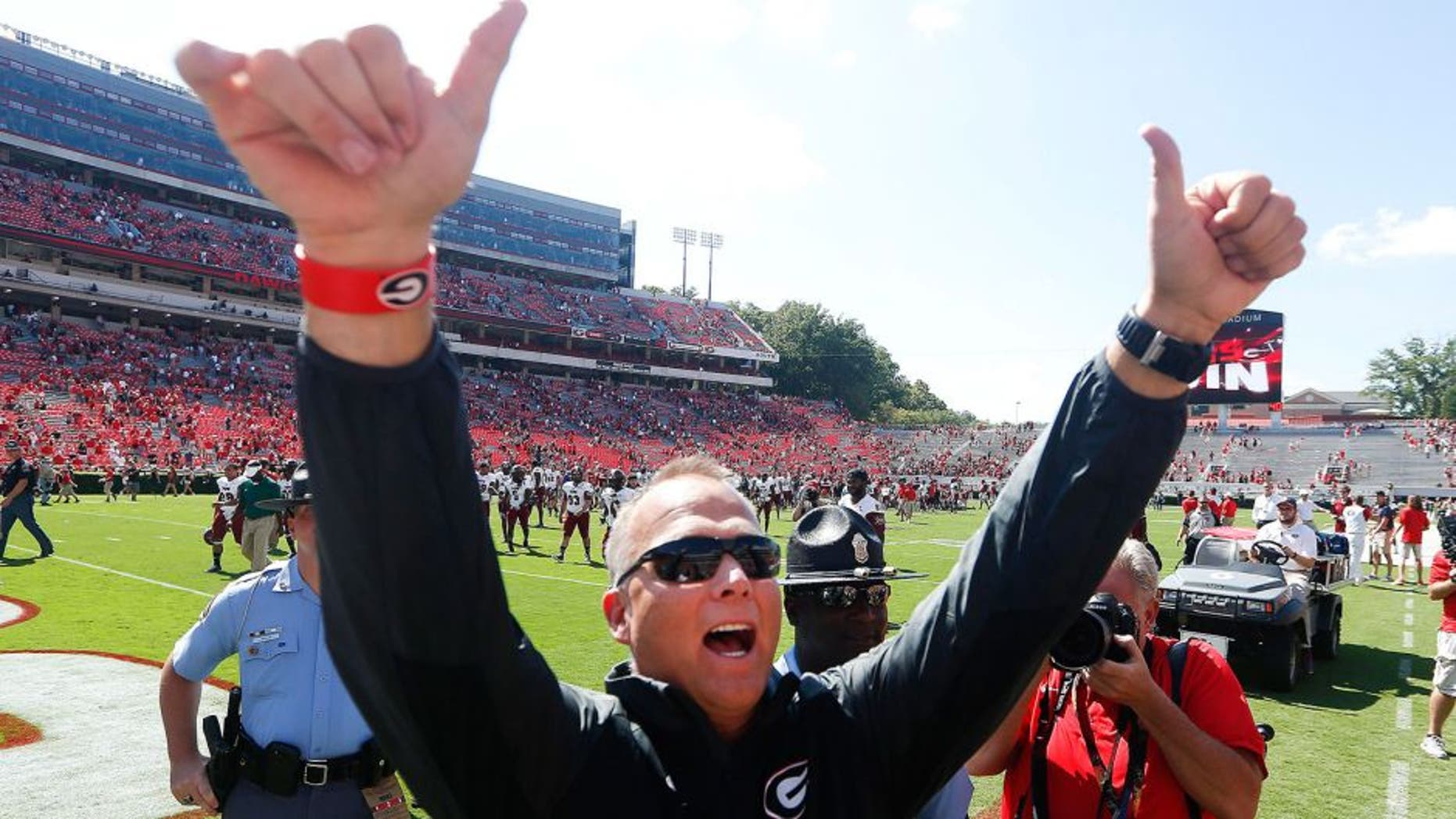 Georgia head coach Mark Richt gestures toward the crowd after defeating Troy 66-0 in an NCAA college football game, Saturday, Sept. 20, 2014, in Athens, Ga. (AP Photo/John Bazemore)