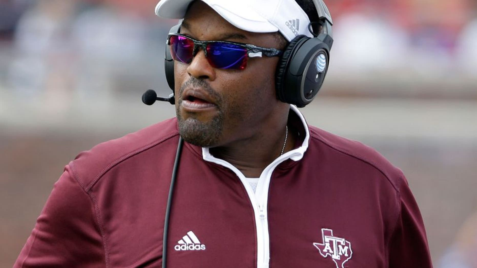 Texas A&M head coach Kevin Sumlin watches a play in the first half of an NCAA college football game against SMU, Saturday, Sept. 20, 2014, in Dallas. (AP Photo/Tony Gutierrez)