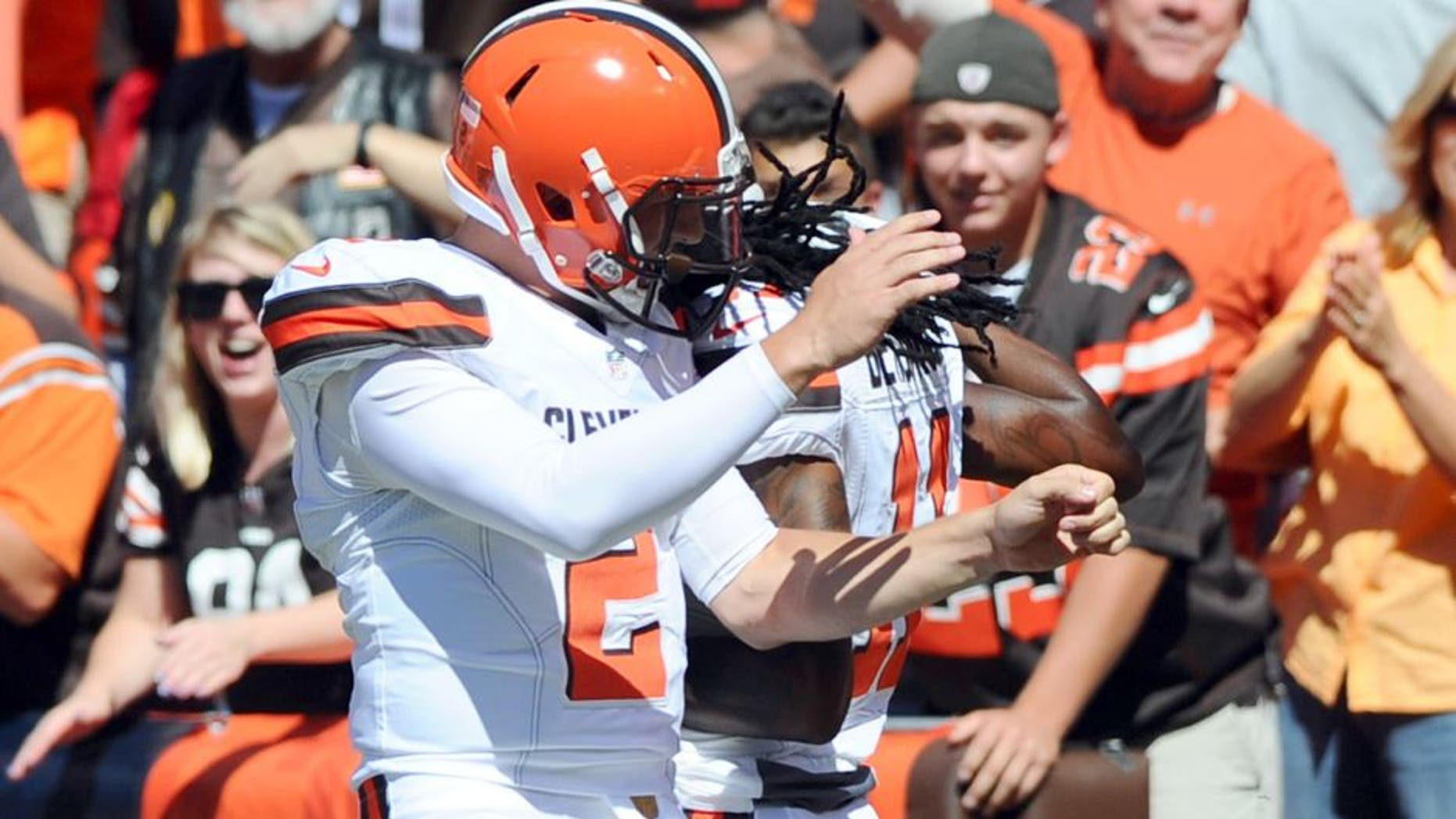 Sep 20, 2015; Cleveland, OH, USA; Cleveland Browns quarterback Johnny Manziel (2) and wide receiver Travis Benjamin (11) celebrate a first quarter touchdown pass against the Tennessee Titans at FirstEnergy Stadium. Mandatory Credit: Ken Blaze-USA TODAY Sports