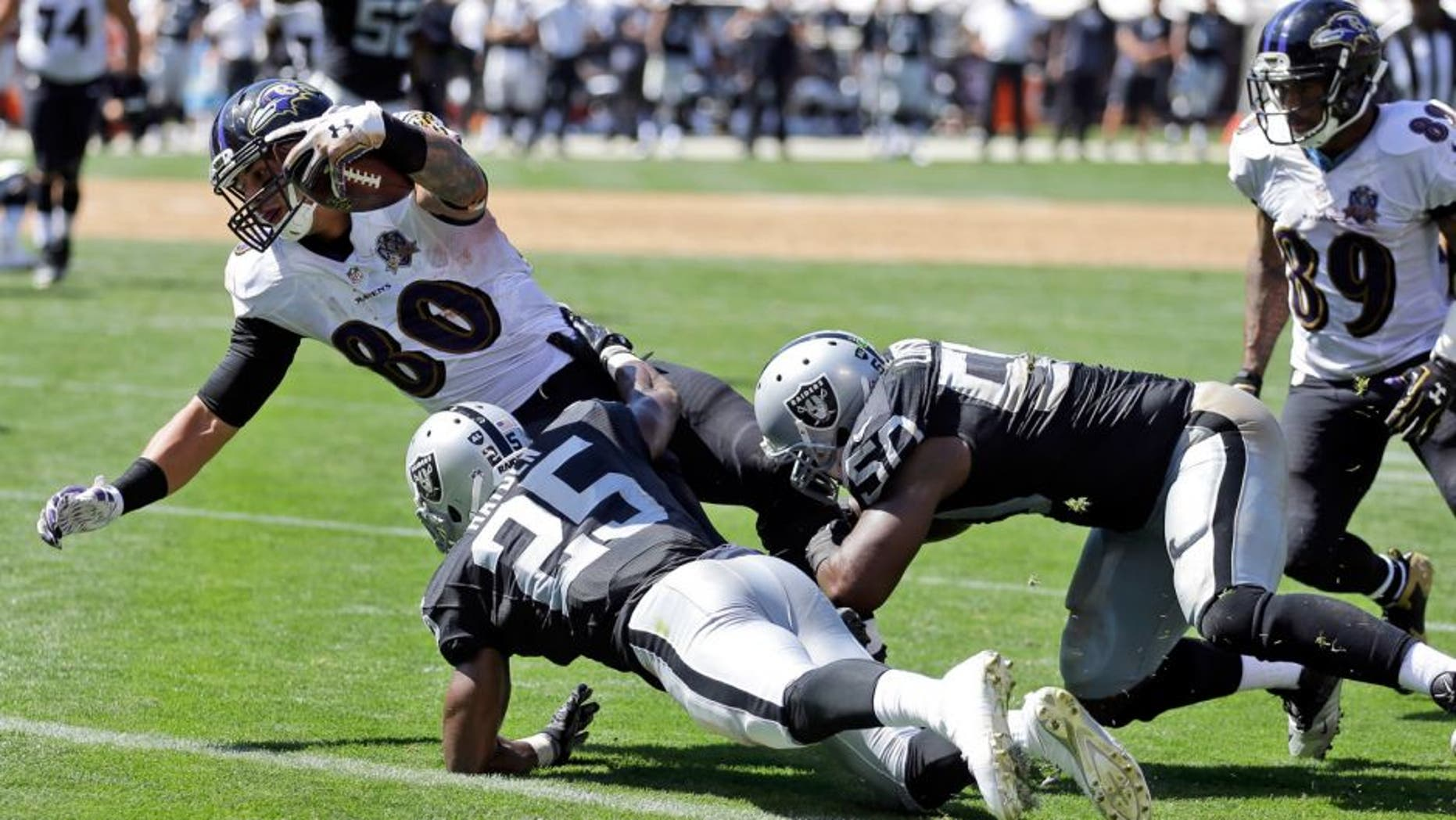 Baltimore Ravens' Crockett Gillmore (80) scores on a 9-yard reception during an NFL football game against the Oakland Raiders, Sunday, Sept. 20, 2015, in Oakland , Calif. (AP Photo/Ben Margot)