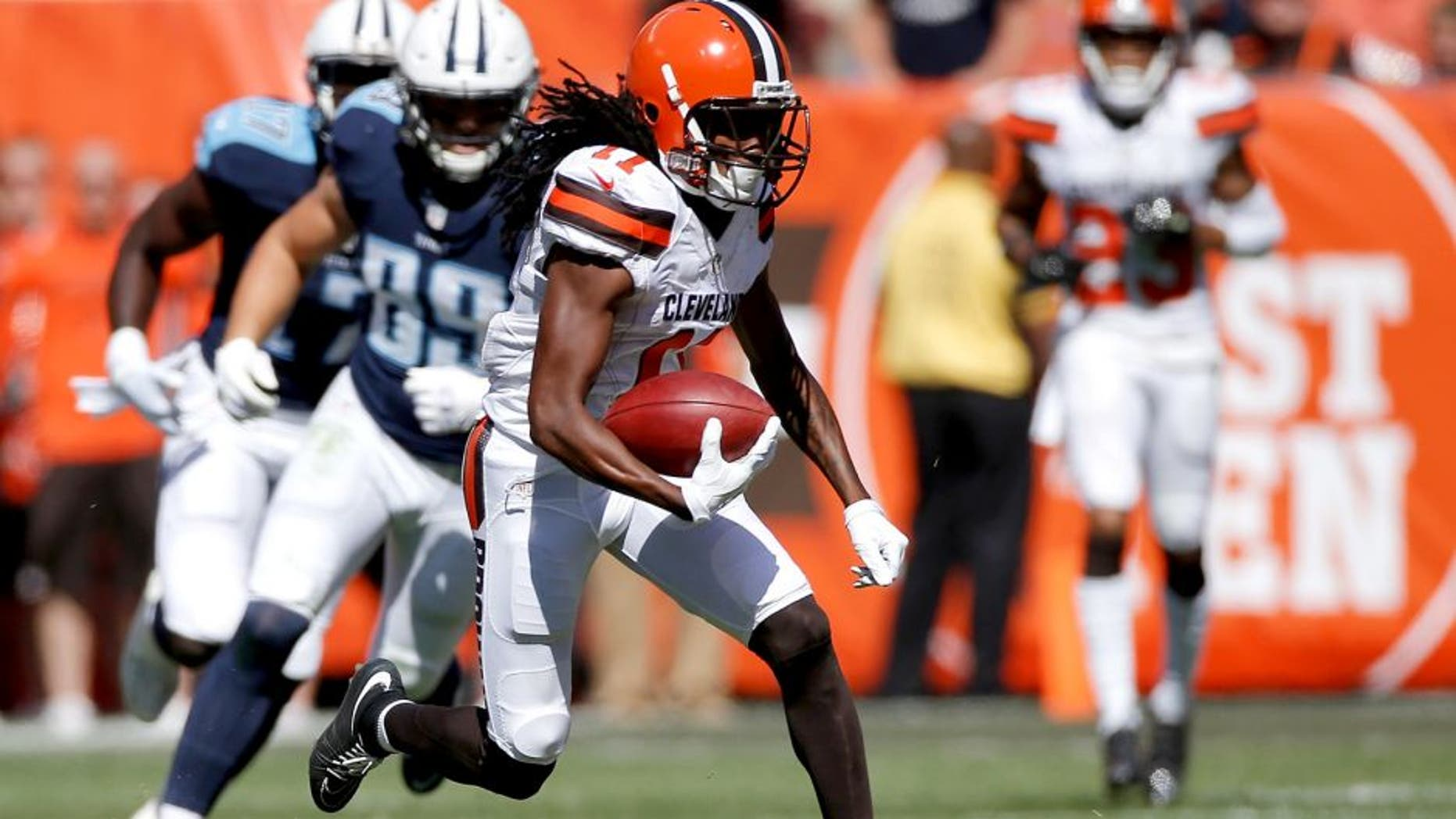 CLEVELAND, OH - SEPTEMBER 20: Travis Benjamin #11 of the Cleveland Browns returns a second quarter punt for a touchdown while playing the Tennessee Titans at FirstEnergy Stadium on September 20, 2015 in Cleveland, Ohio. (Photo by Gregory Shamus/Getty Images)