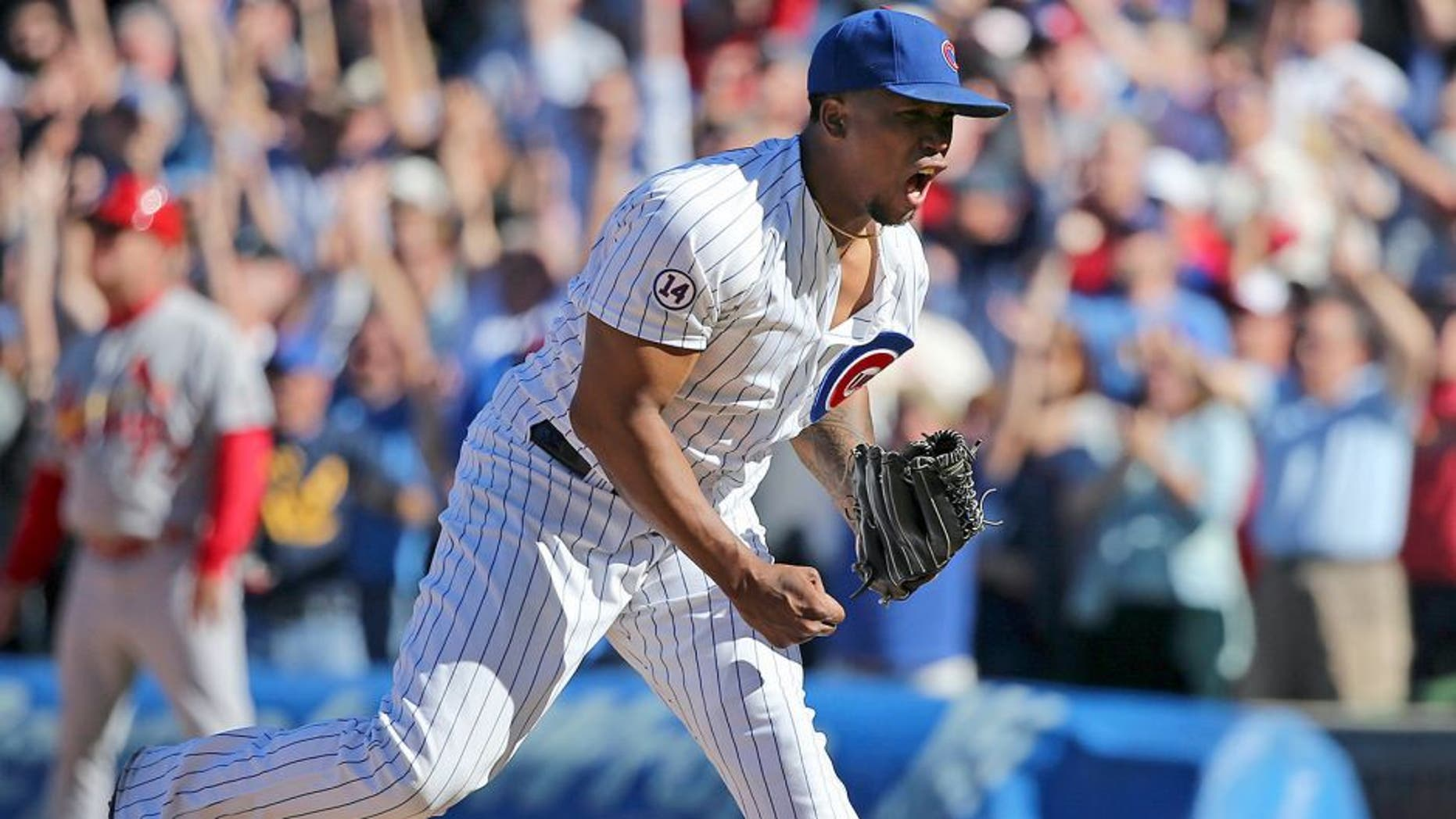 Chicago Cubs pitcher Pedro Strop celebrates after the last out during the ninth inning in a 5-4 win against the St. Louis Cardinals at Wrigley Field, in Chicago on Saturday, Sept. 19, 2015. The Cubs won, 5-4. (Nuccio DiNuzzo/Chicago Tribune/TNS via Getty Images)