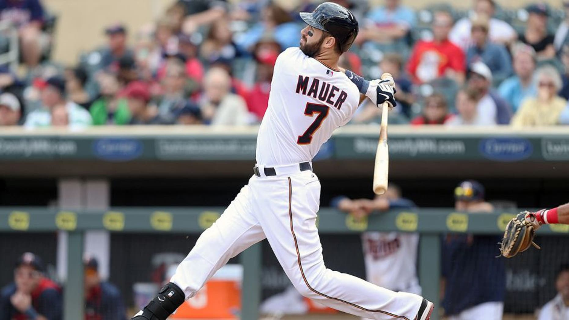 MINNEAPOLIS, MN - SEPTEMBER 20: Joe Mauer #7 of the Minnesota Twins hits a solo home run in the 8th inning against the Los Angeles Angels of Anaheim at Target Field on September 20, 2015 in Minneapolis, Minnesota. The Twins defeated the Angels 8-1. (Photo by David Sherman/Getty Images)